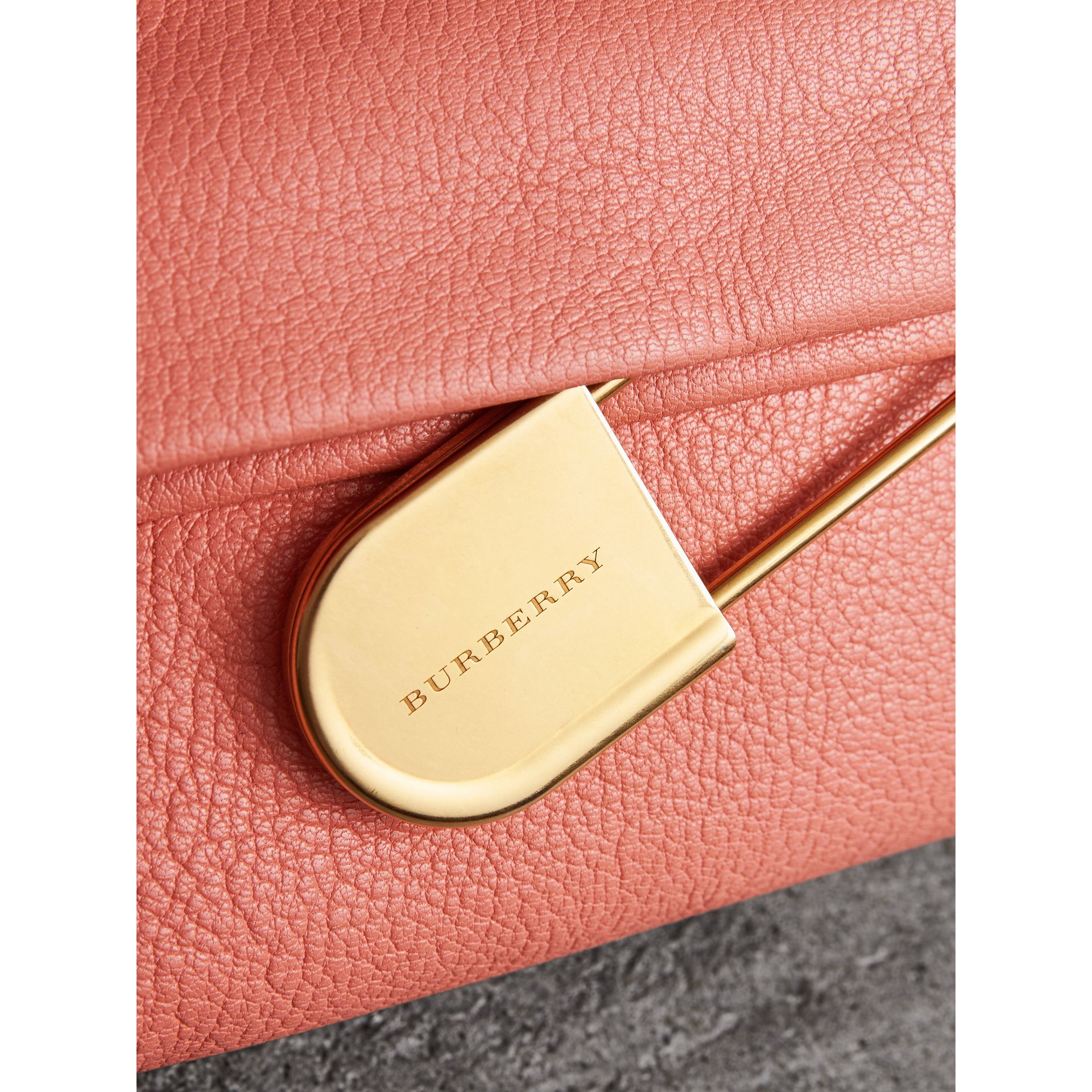 The Medium Pin Clutch in Leather in Bright Coral Pink - Women | Burberry United Kingdom - gallery image 1