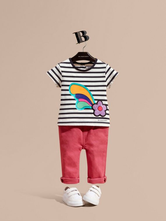 T-shirt in cotone a righe con stampa e applicazione floreale
