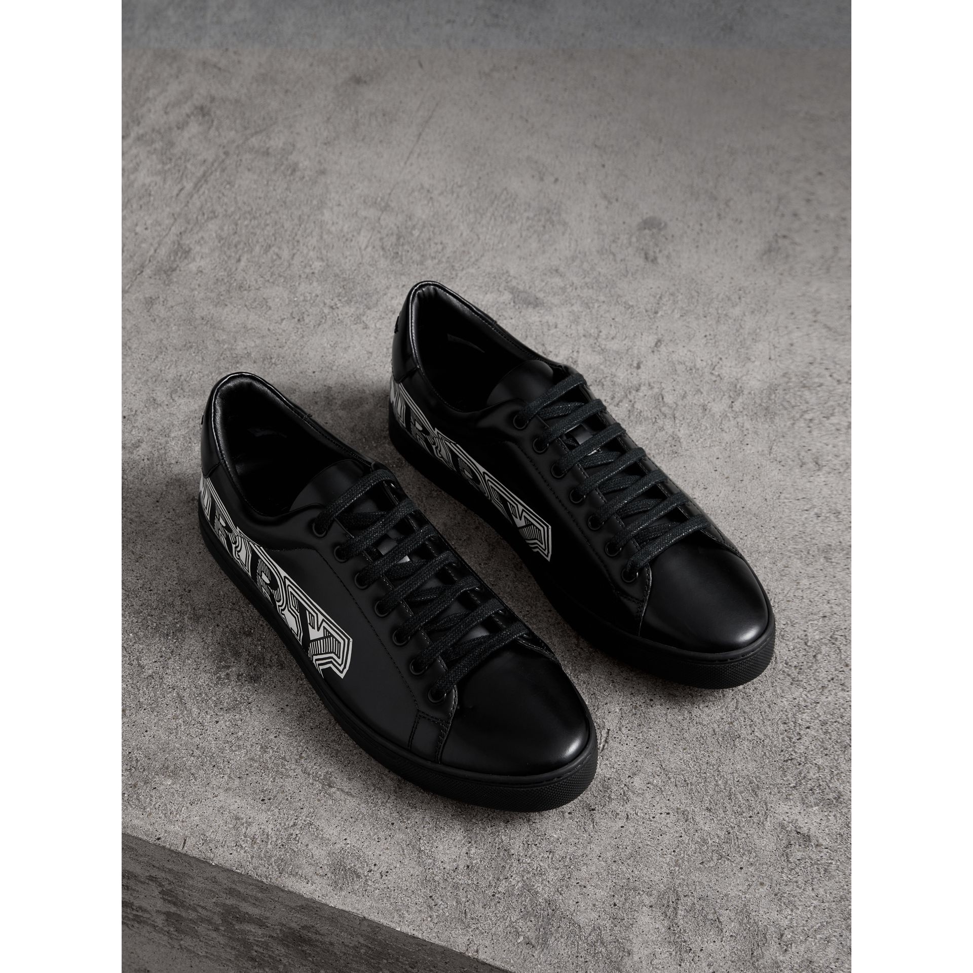 Doodle Print Leather Trainers in Black - Men | Burberry - gallery image 1