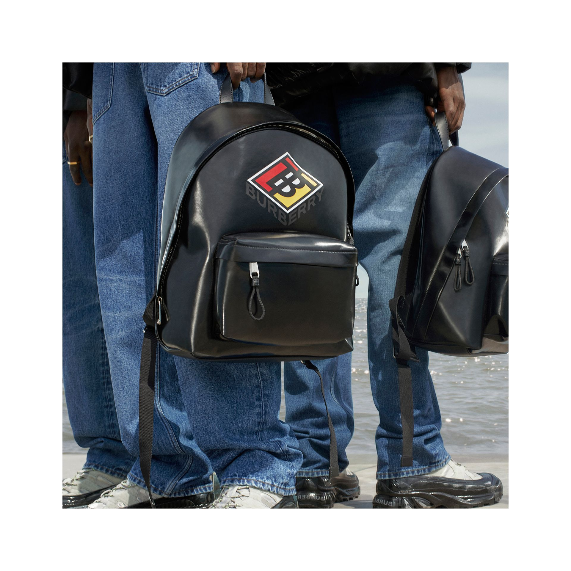 Logo Graphic Coated Canvas Backpack in Black | Burberry Hong Kong S.A.R - gallery image 1