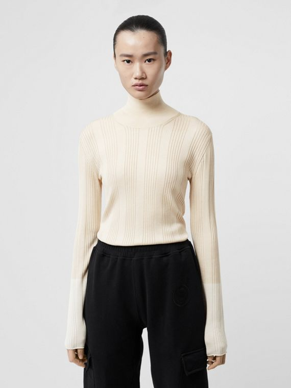 Rib Knit Silk Turtleneck Sweater in Natural White