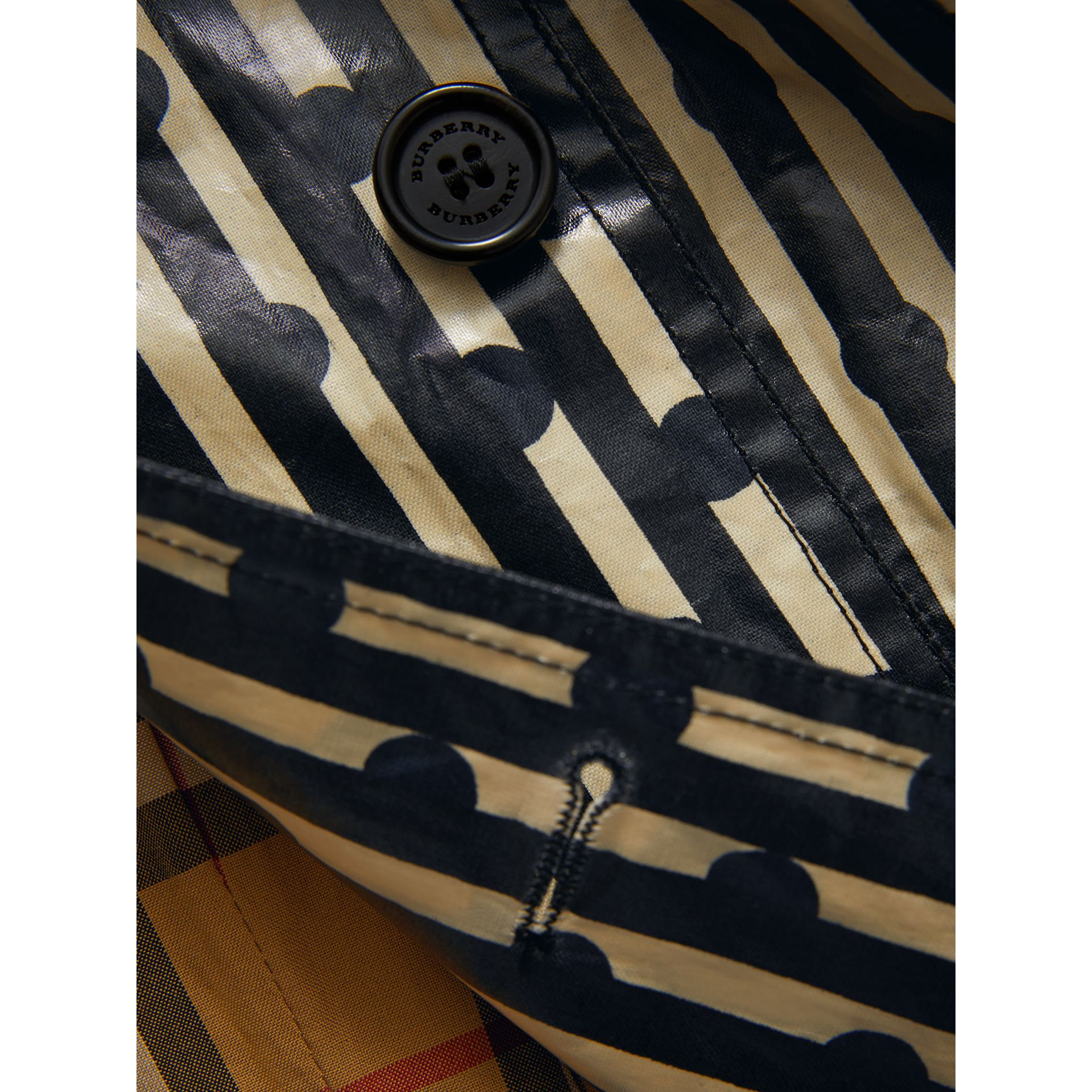 Laminated Spot and Stripe Print Trench Coat in Navy | Burberry United Kingdom - gallery image 1