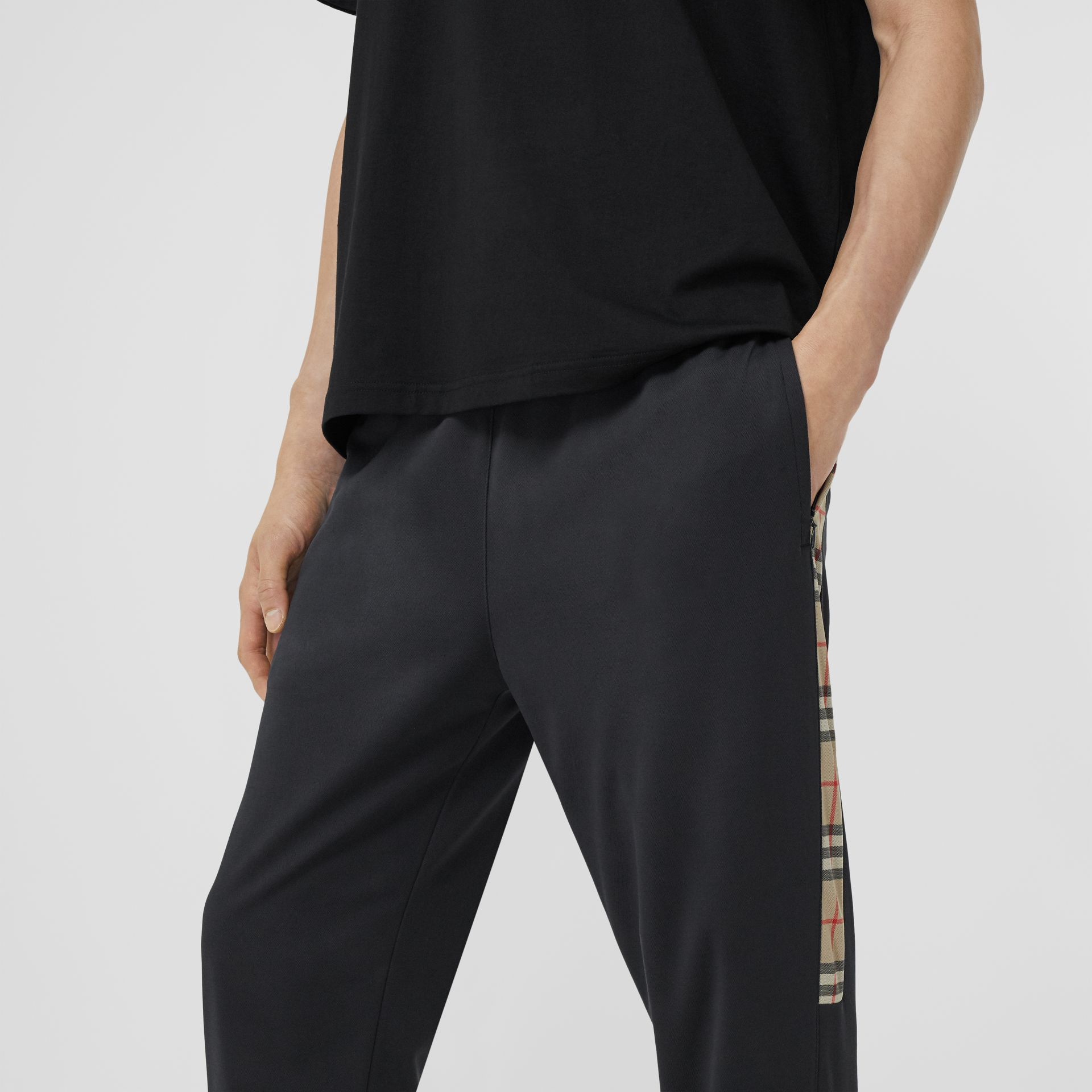 Vintage Check Trim Technical Twill Trackpants in Black - Men   Burberry - gallery image 1