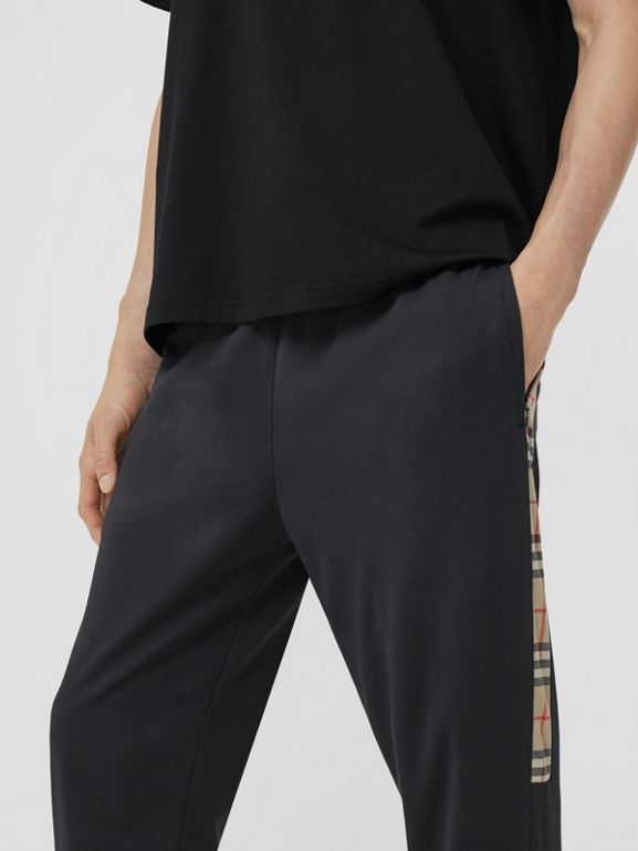 Vintage Check Trim Technical Twill Trackpants in Black - Men   Burberry - cell image 1
