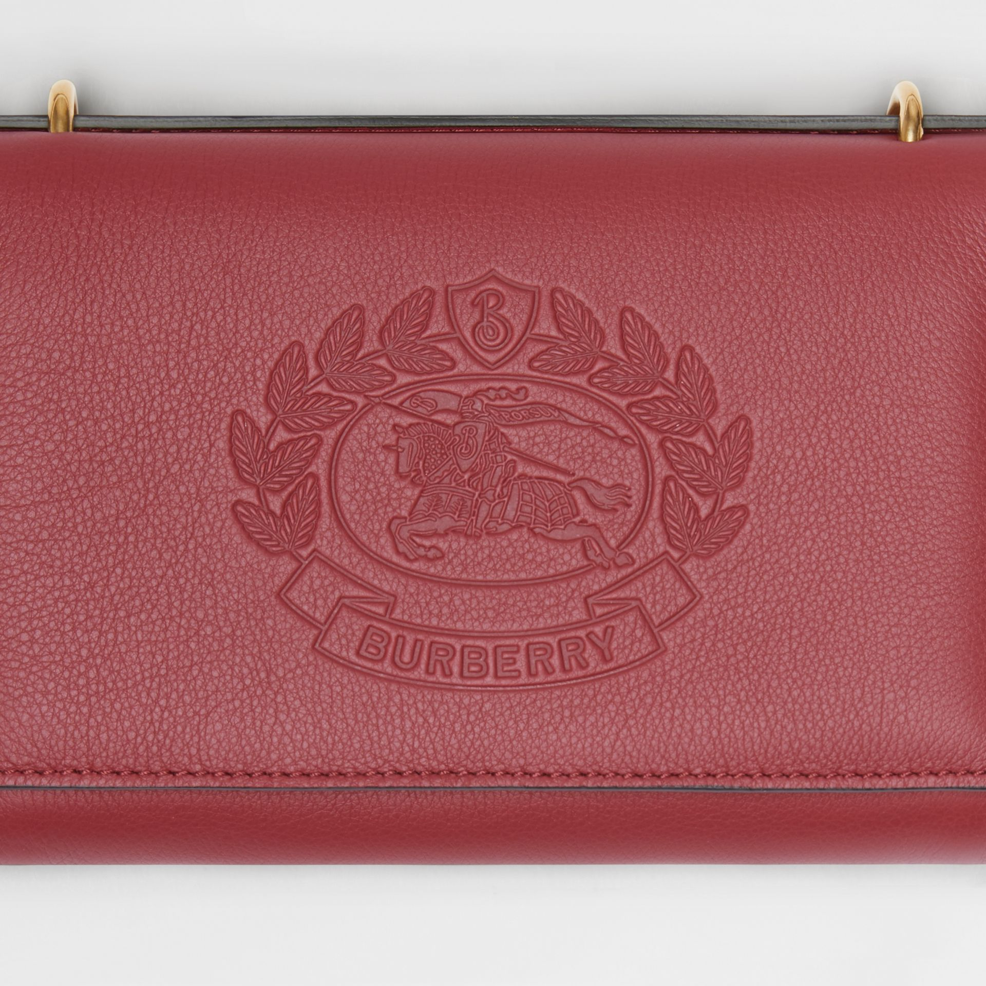 Embossed Crest Leather Wallet with Detachable Strap in Crimson - Women | Burberry Australia - gallery image 1