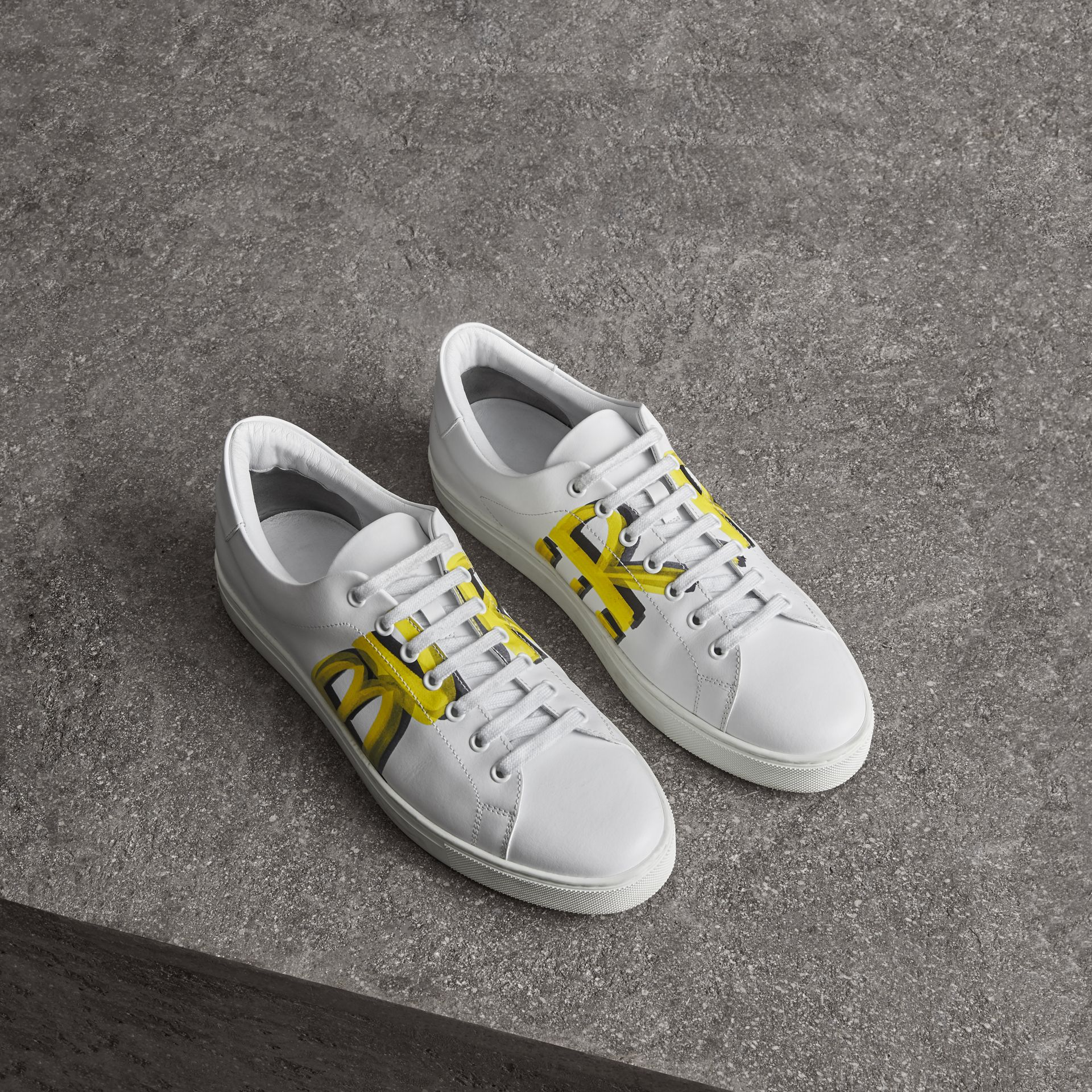 Logo Print Leather Sneakers in Optic White/yellow - Men | Burberry Australia - gallery image 0
