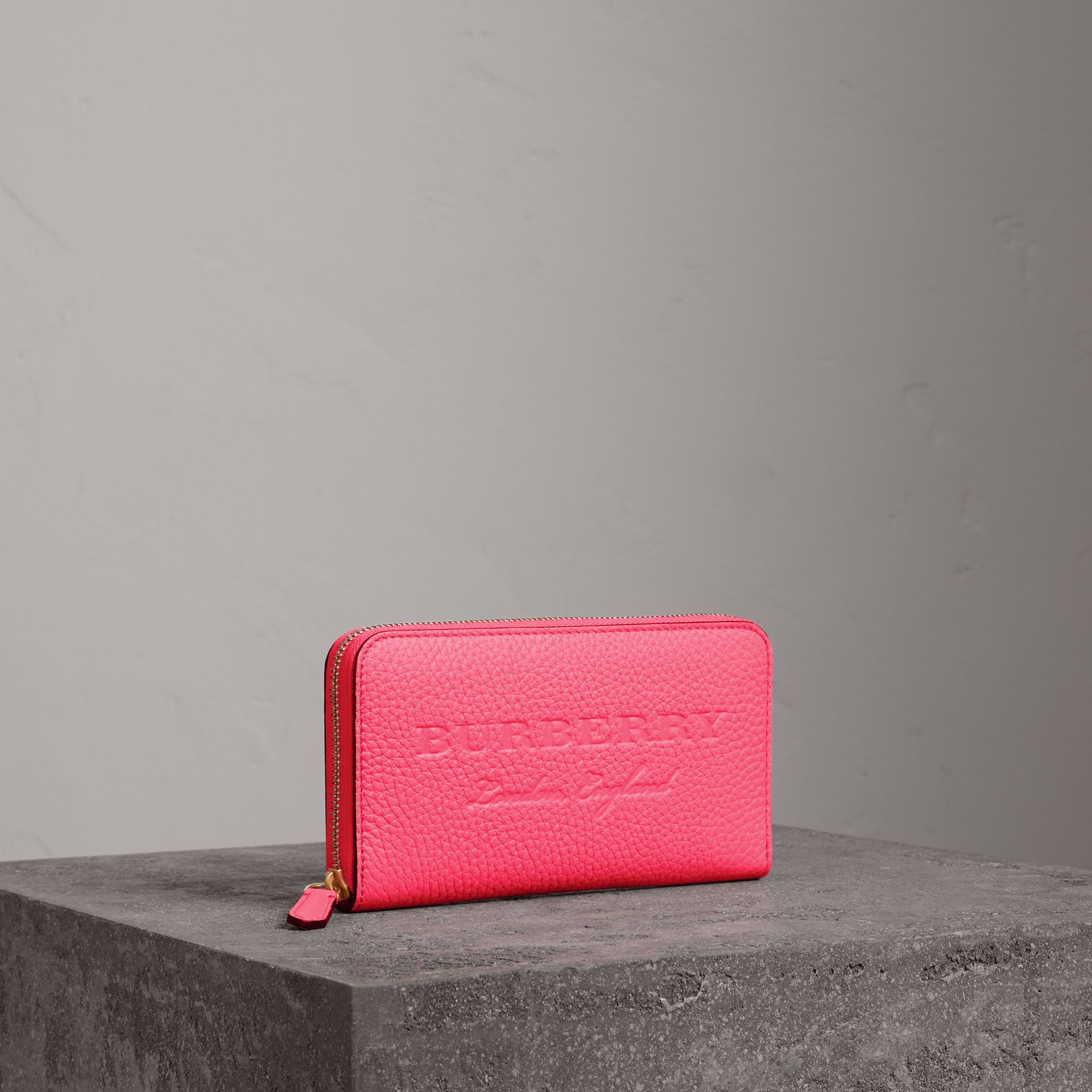 Embossed Leather Ziparound Wallet in Bright Pink - Women | Burberry United Kingdom - gallery image 0