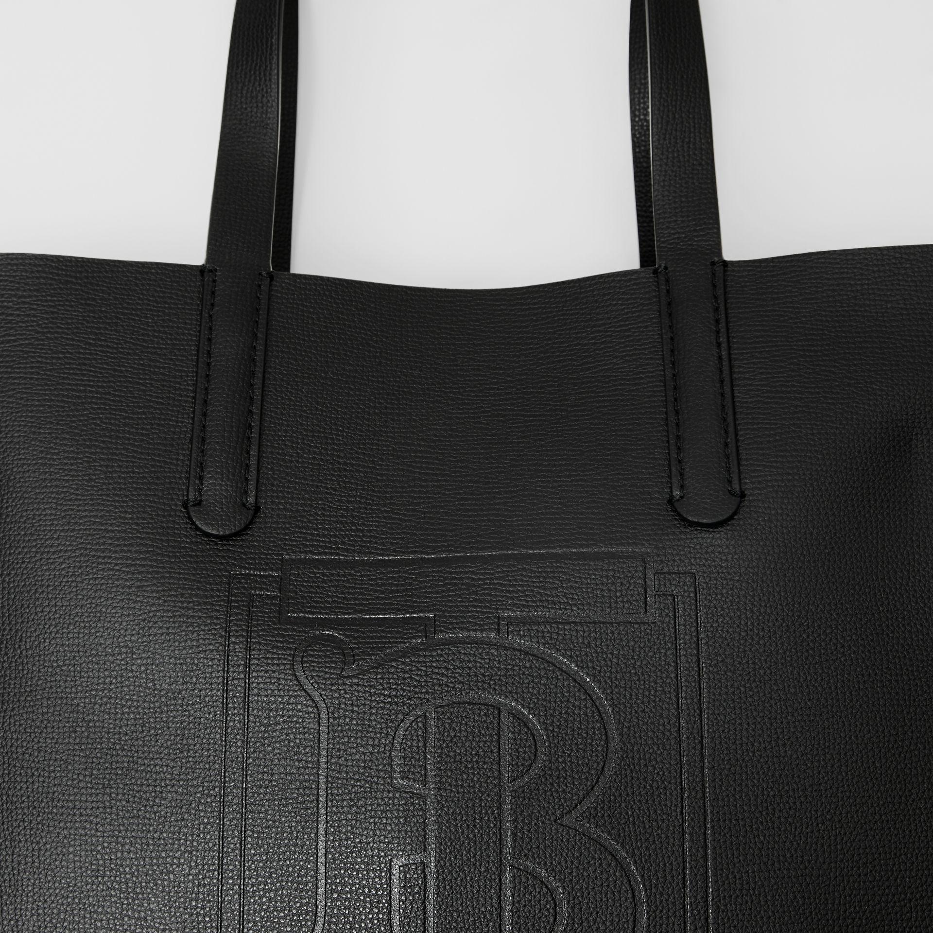 Embossed Monogram Motif Leather Tote in Black - Women | Burberry - gallery image 1