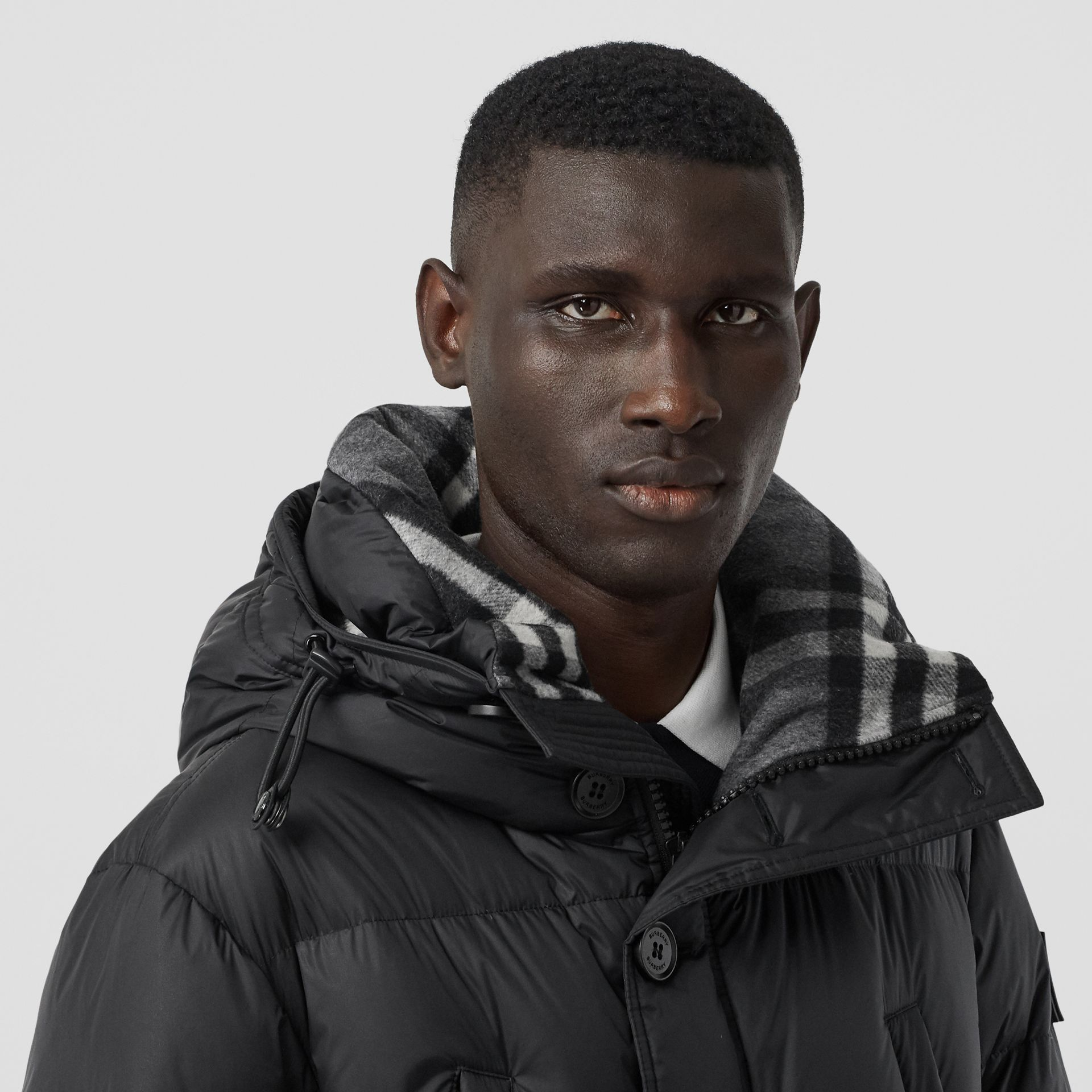Logo Detail Hooded Puffer Coat in Black - Men | Burberry United Kingdom - gallery image 1