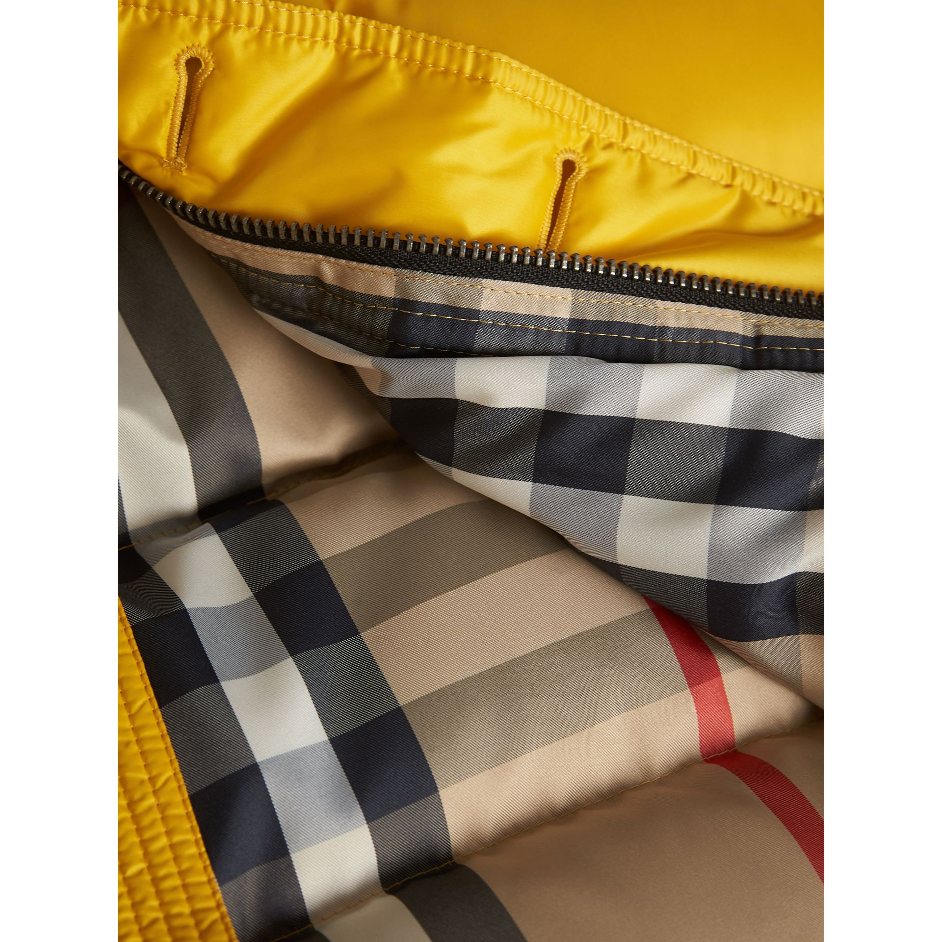 Shower-resistant Hooded Puffer Jacket in Larch Yellow - Boy | Burberry Australia - gallery image 2