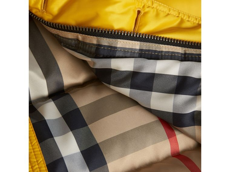 Shower-resistant Hooded Puffer Jacket in Larch Yellow - Boy | Burberry - cell image 1