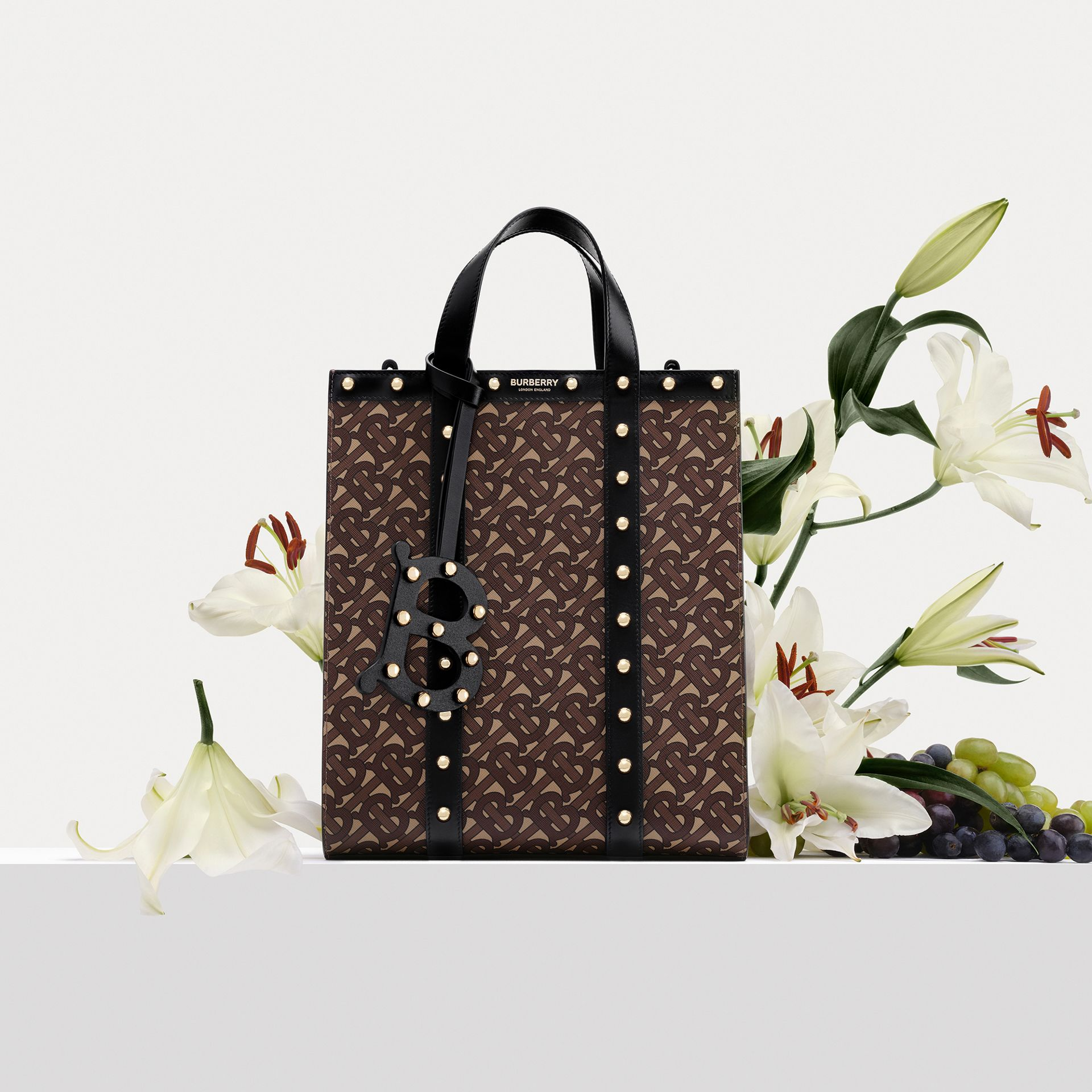 Monogram Print E-canvas Portrait Tote Bag in Black | Burberry Hong Kong S.A.R - gallery image 1