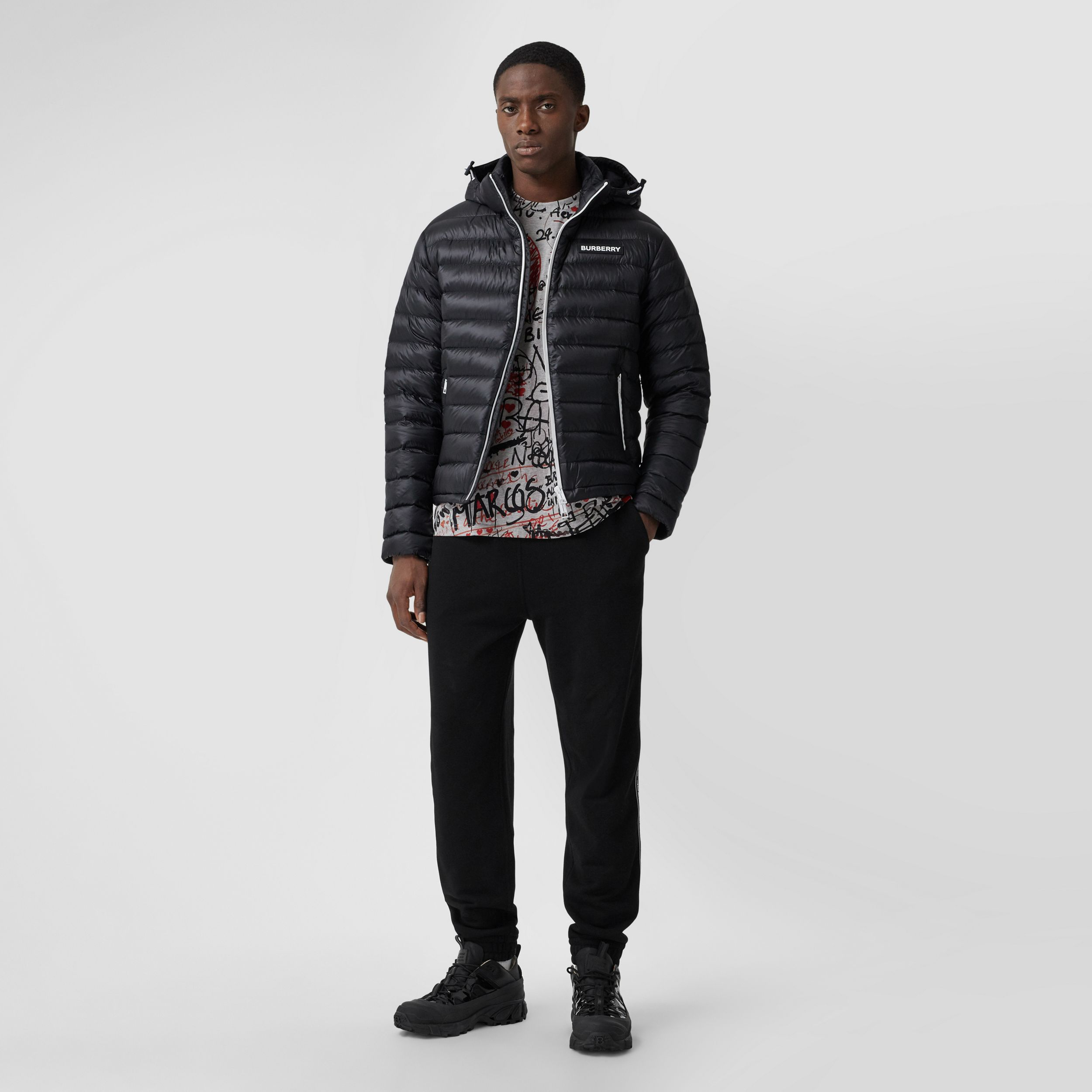 Detachable Hood Logo Appliqué Puffer Jacket in Black - Men | Burberry - 1