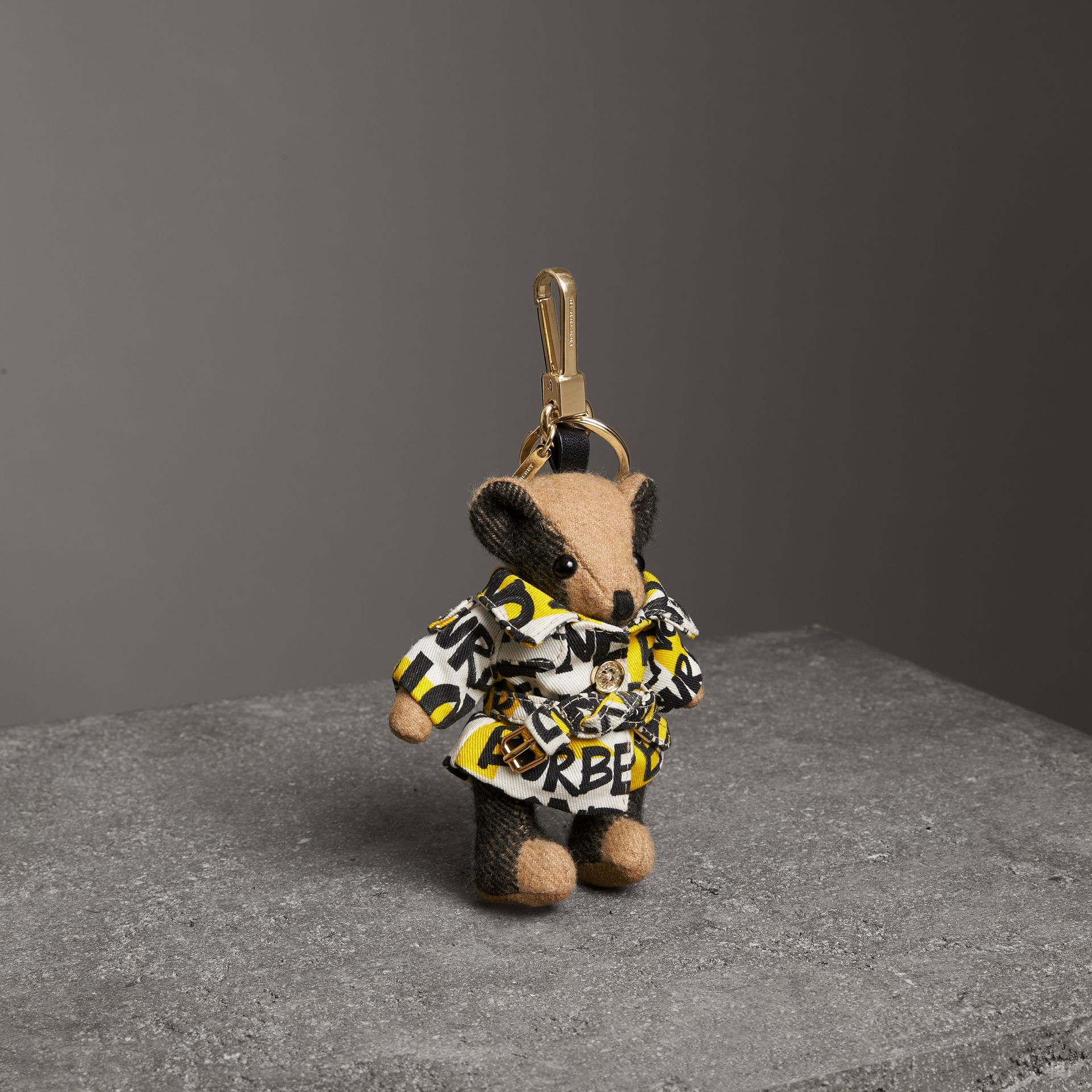 Thomas Bear Charm in Graffiti Print Trench Coat in Camel | Burberry Australia - gallery image 0