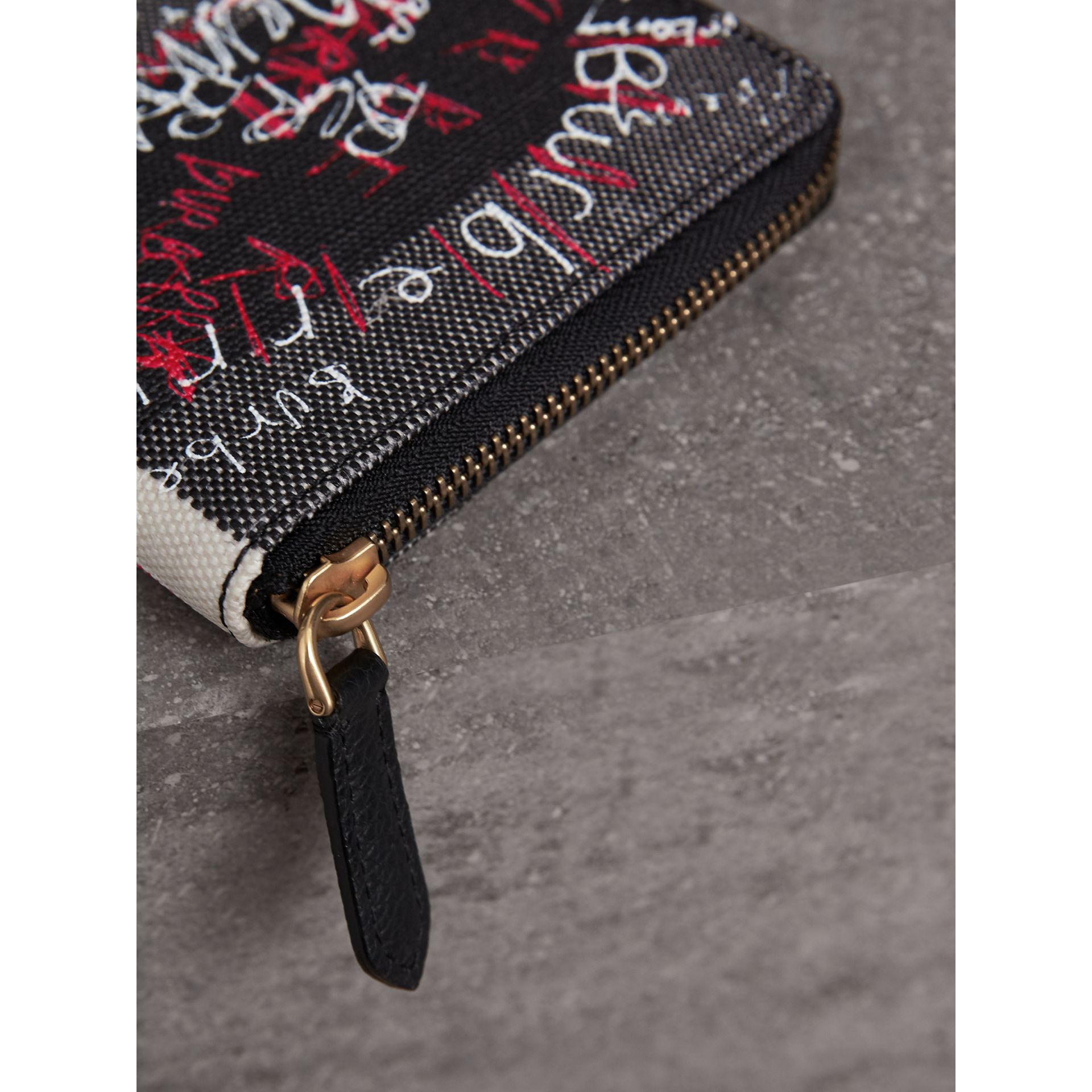 Doodle Print Coated Check Canvas Ziparound Wallet in Black - Men | Burberry - gallery image 1