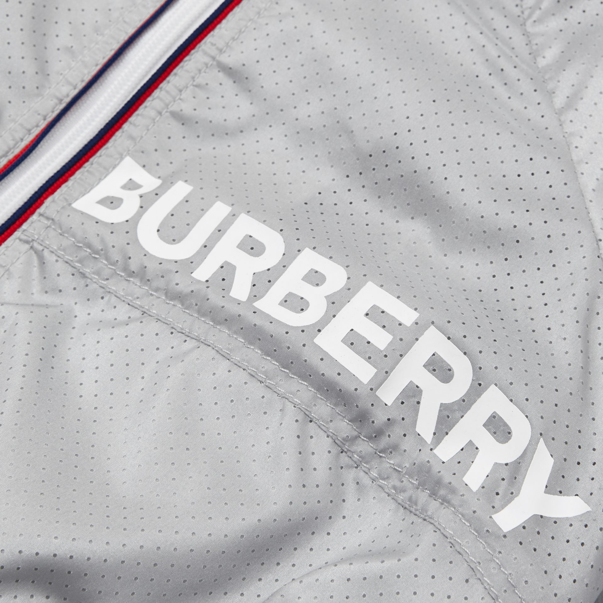 Logo Print Perforated Hooded Jacket in Silver - Children | Burberry - gallery image 1