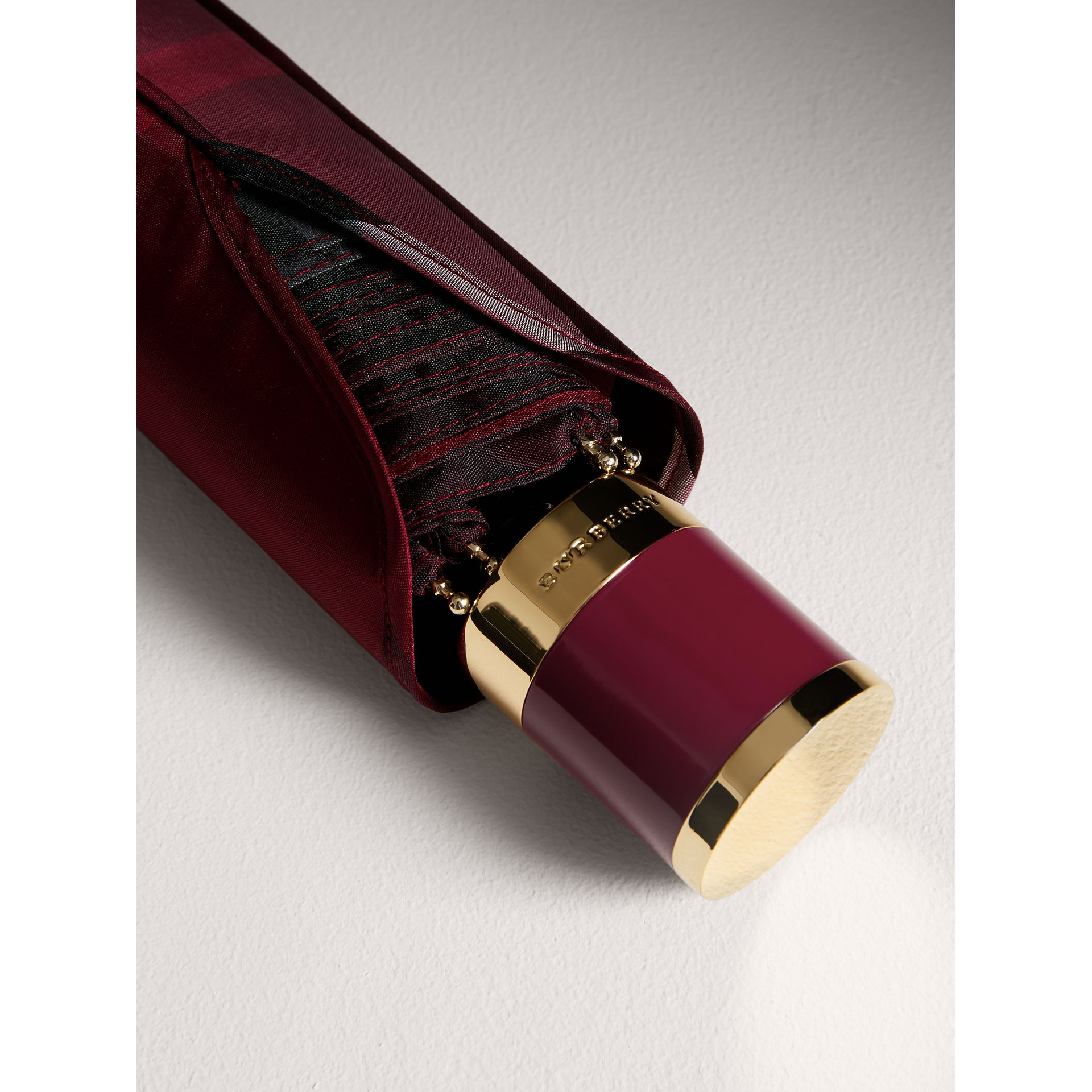 Check Folding Umbrella in Plum | Burberry - gallery image 1
