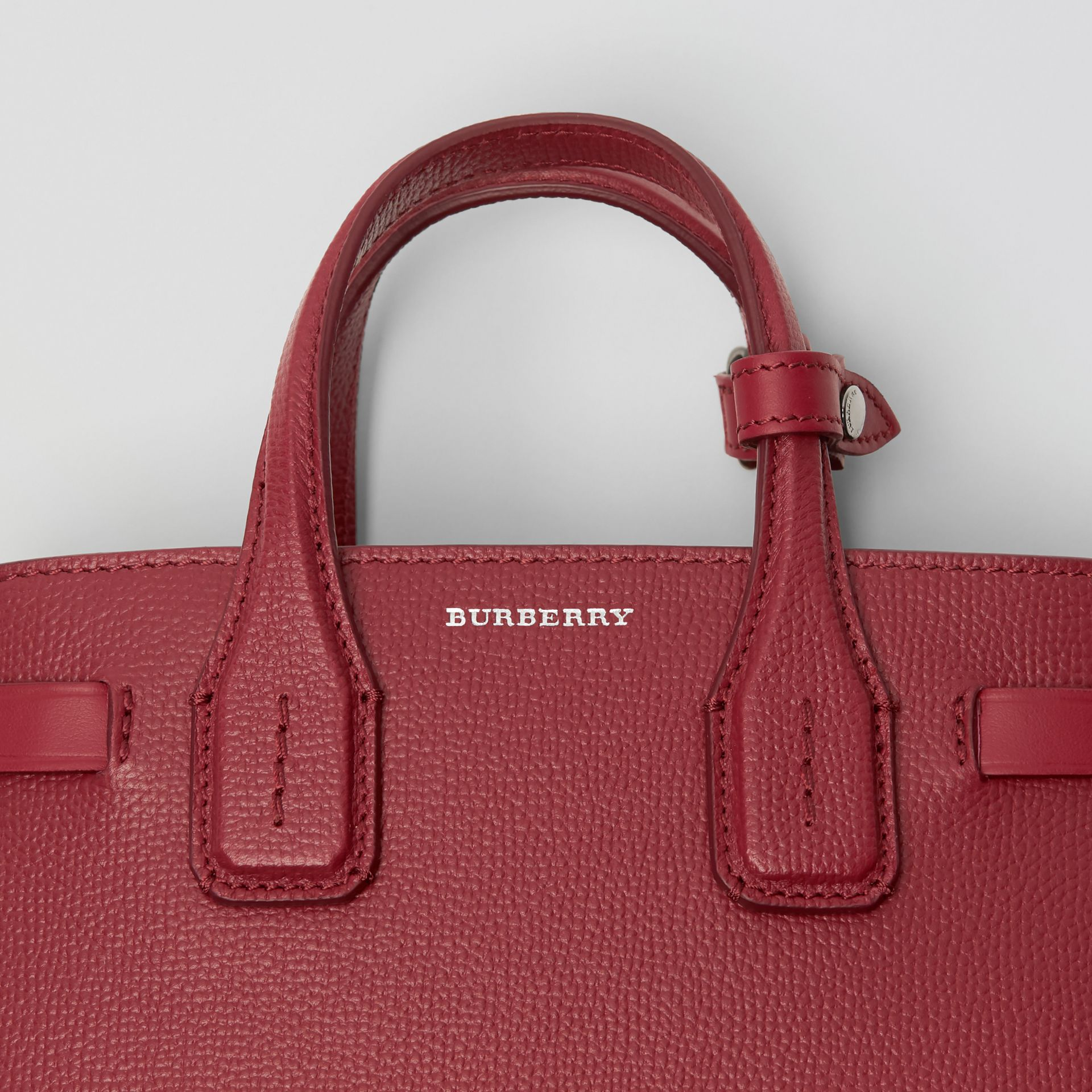 The Baby Banner in Leather and Vintage Check in Crimson - Women | Burberry - gallery image 1