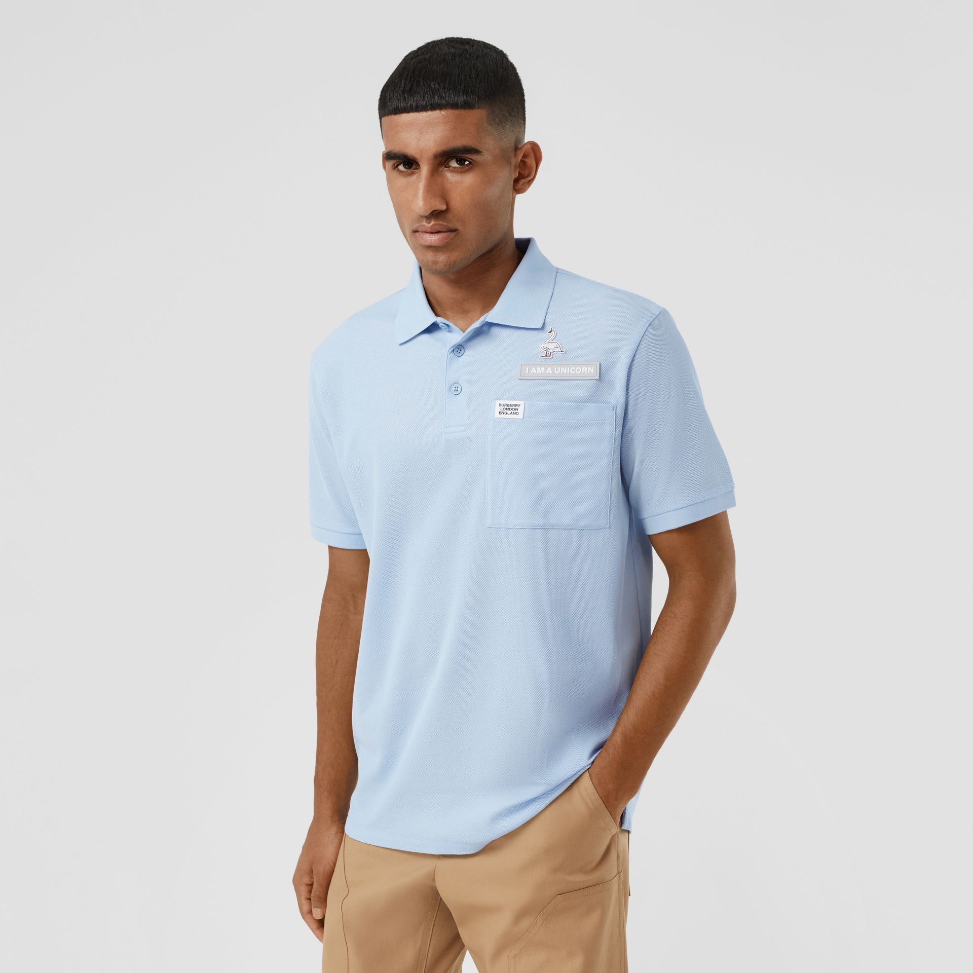 Swan and Slogan Appliqué Cotton Polo Shirt in Pale Blue - Men | Burberry - gallery image 0