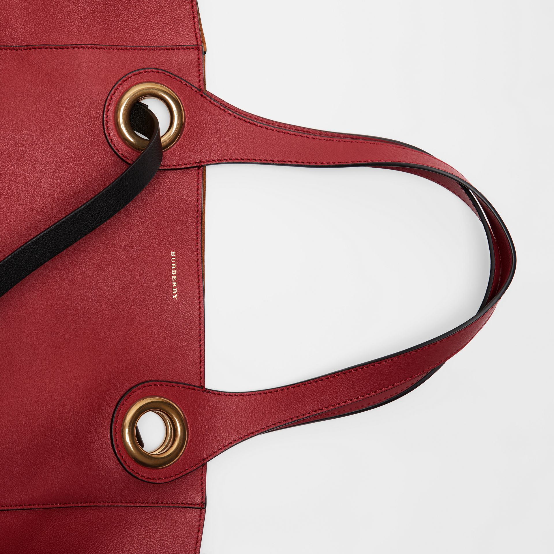 The Medium Leather Grommet Detail Tote in Crimson - Women | Burberry - gallery image 1