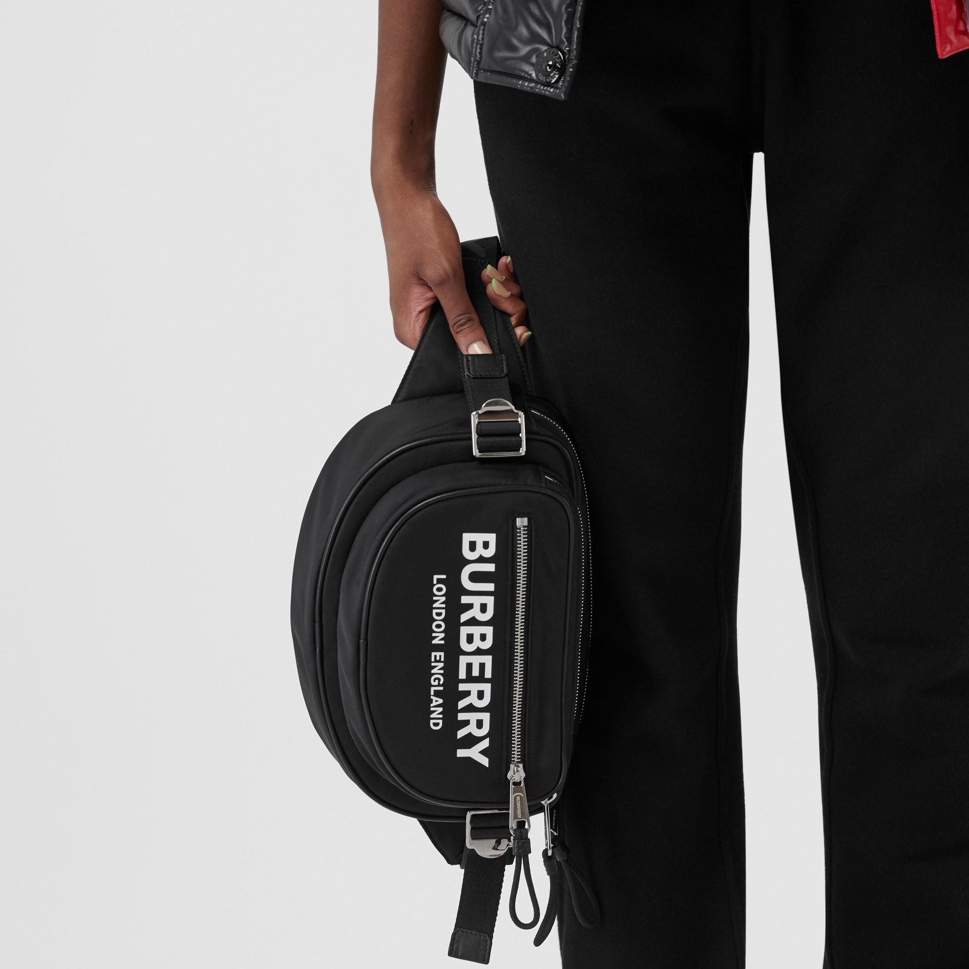 Medium Logo Print ECONYL® Cannon Bum Bag in Black - Men | Burberry United Kingdom - gallery image 6