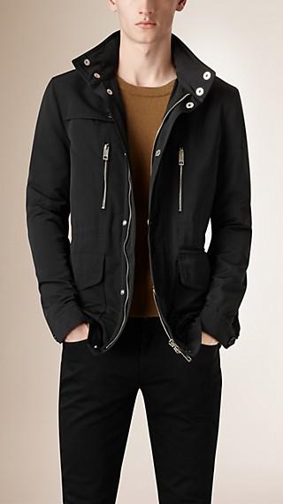 Veste utilitaire avec capuche repliable