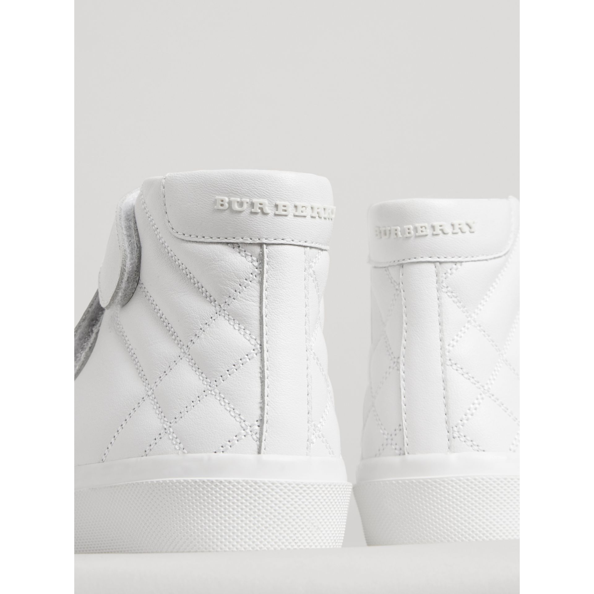 Check-quilted Leather High-top Sneakers in Optic White - Children | Burberry - gallery image 1