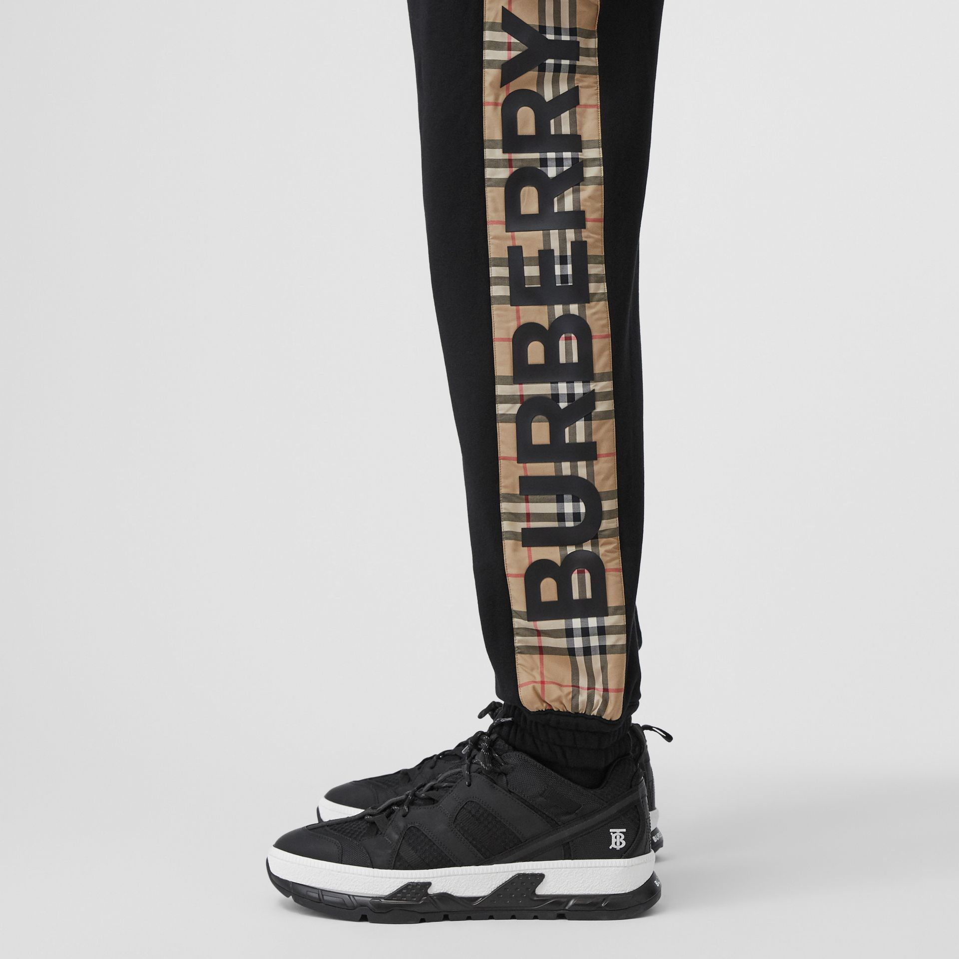 Logo Print Check Panel Cotton Trackpants in Black - Men | Burberry - gallery image 3