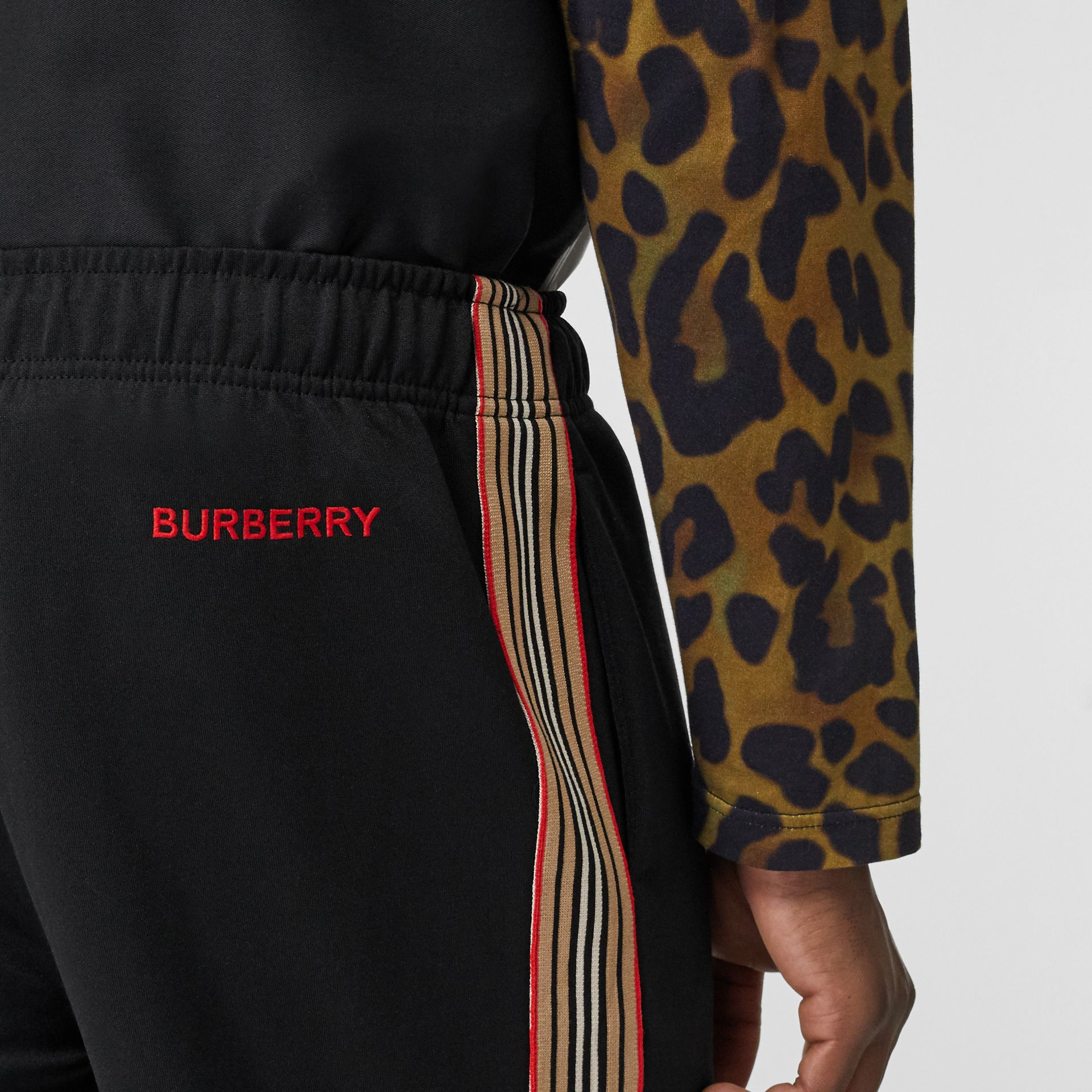 Icon Stripe Detail Jersey Trackpants in Black - Men | Burberry - gallery image 1