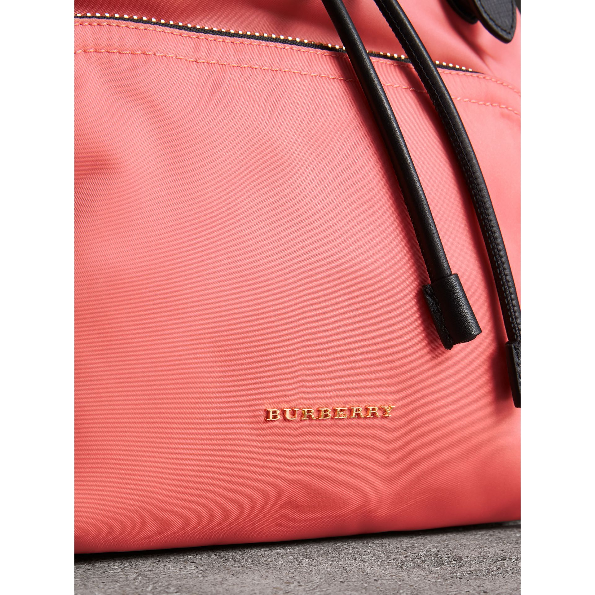 The Medium Rucksack in Technical Nylon and Leather in Bright Coral Pink - Women | Burberry United Kingdom - gallery image 1