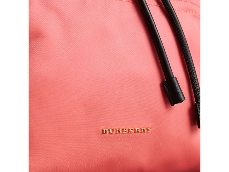The Medium Rucksack in Technical Nylon and Leather in Bright Coral Pink - Women | Burberry Singapore - cell image 1