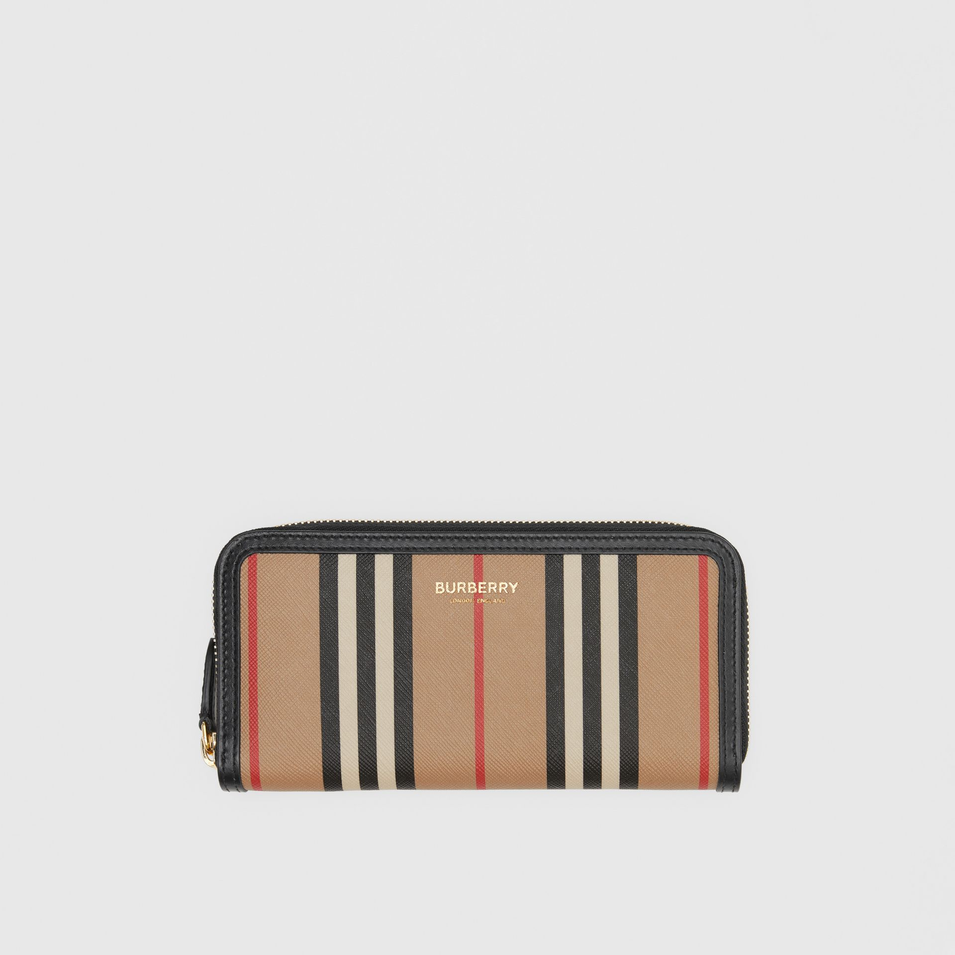 Icon Stripe E-canvas and Leather Ziparound Wallet in Archive Beige - Women | Burberry - gallery image 0