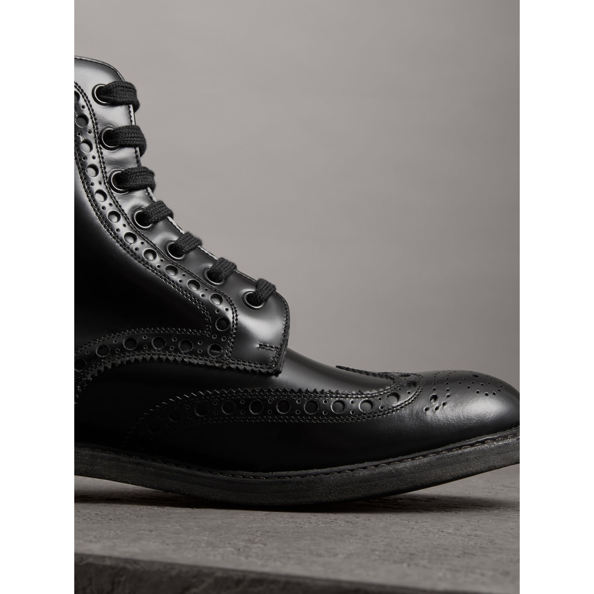 Brogue Detail Polished Leather Boots in Black - Men | Burberry - gallery image 1
