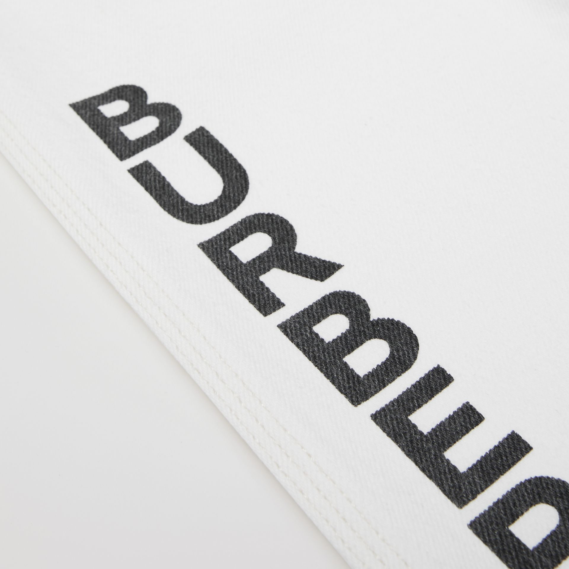 Logo Print Japanese Denim Jeans in Natural White   Burberry United Kingdom - gallery image 1