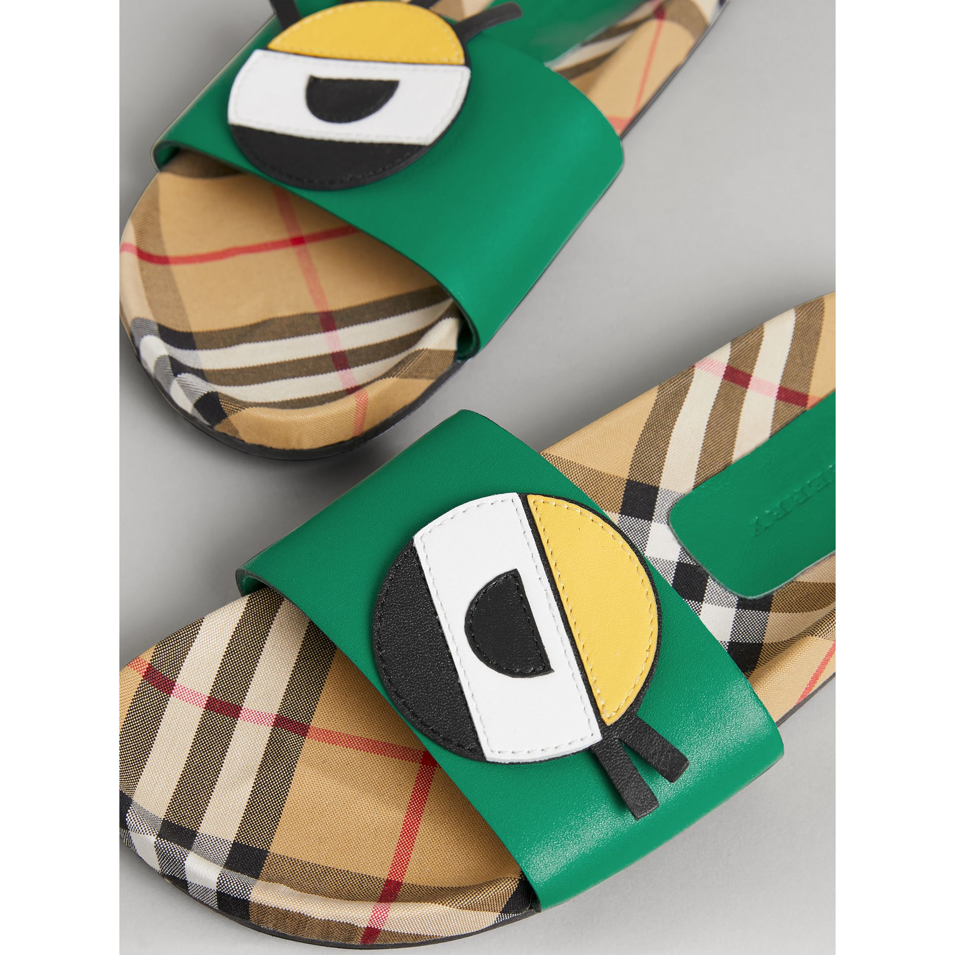 Eye Appliqué Vintage Check and Leather Slides in Bright Pigment Green | Burberry - gallery image 1