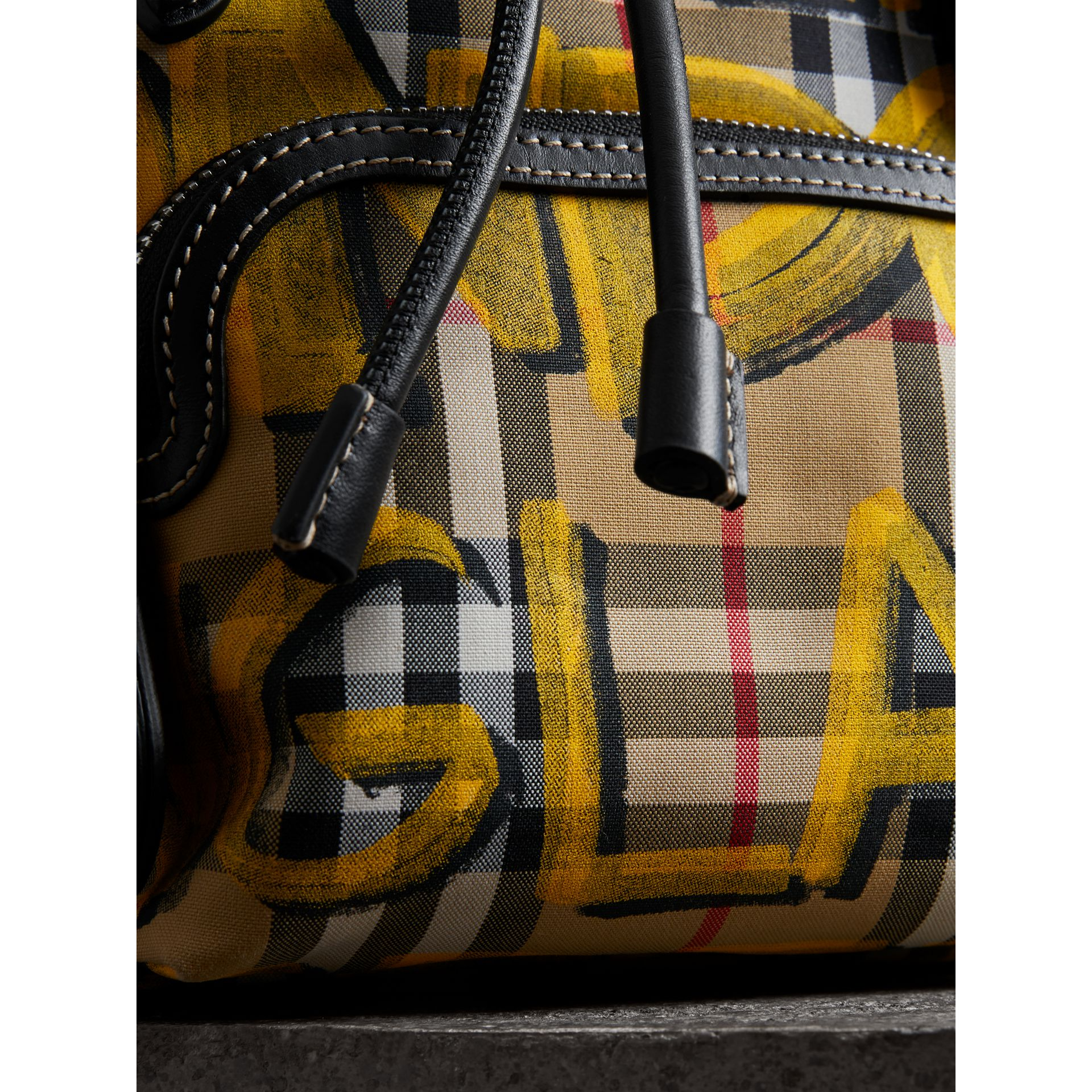 The Small Crossbody Rucksack in Graffiti Print Vintage Check in Black - Women | Burberry United Kingdom - gallery image 1