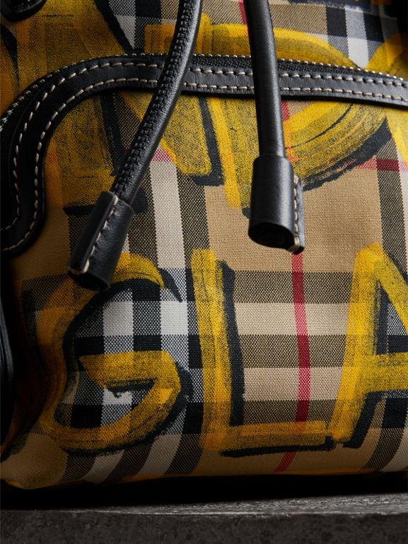 The Small Crossbody Rucksack in Graffiti Print Vintage Check in Black - Women | Burberry United Kingdom - cell image 1