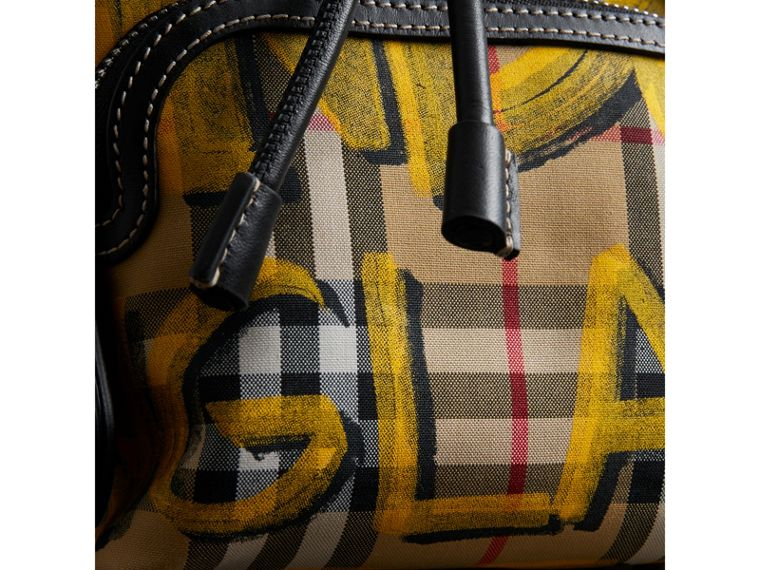 The Small Crossbody Rucksack in Graffiti Print Vintage Check in Black - Women | Burberry Canada - cell image 1