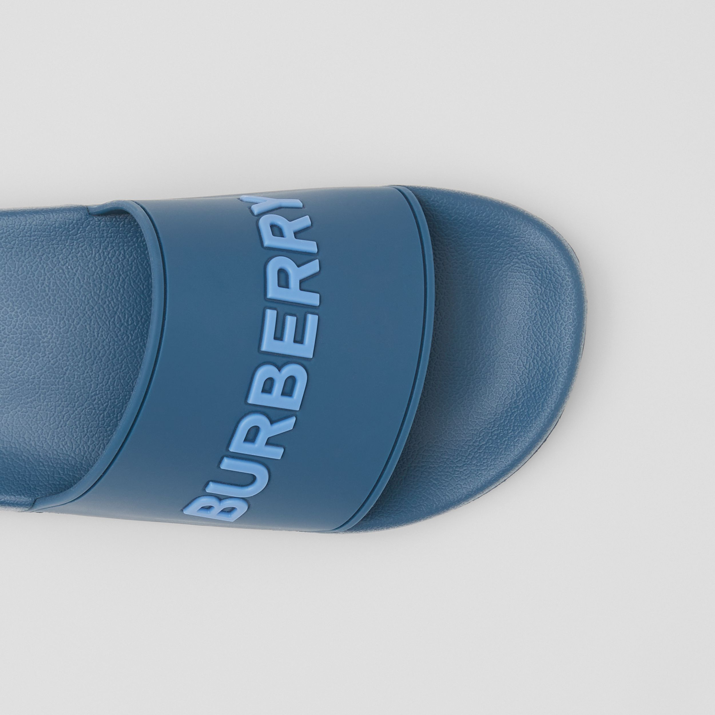 Embossed Logo Slides in Dark Cerulean Blue - Men | Burberry United Kingdom - 2