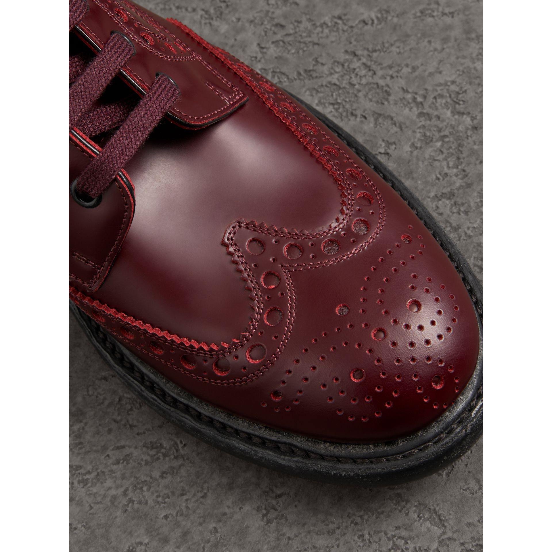 Brogue Detail Polished Leather Boots in Ebony Red - Men | Burberry - gallery image 1