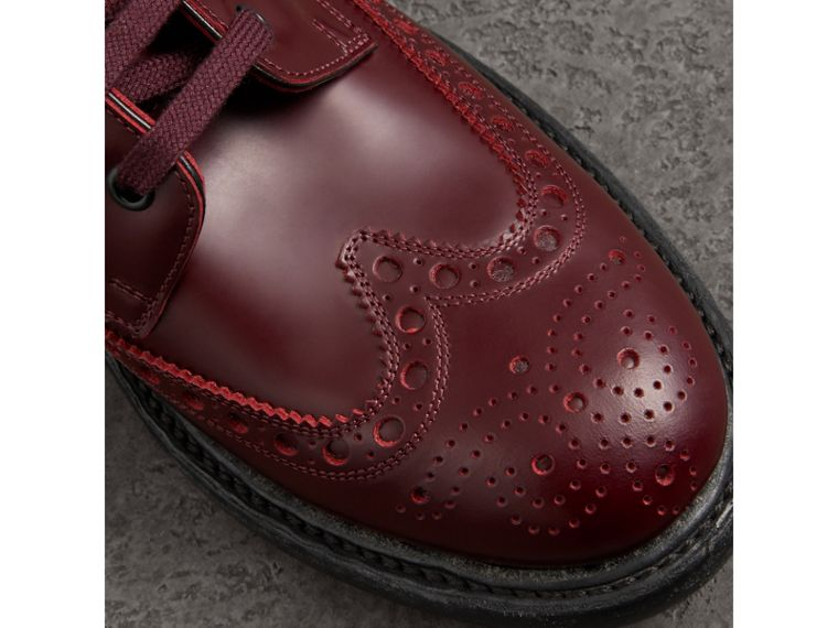 Brogue Detail Polished Leather Boots in Ebony Red - Men | Burberry - cell image 1