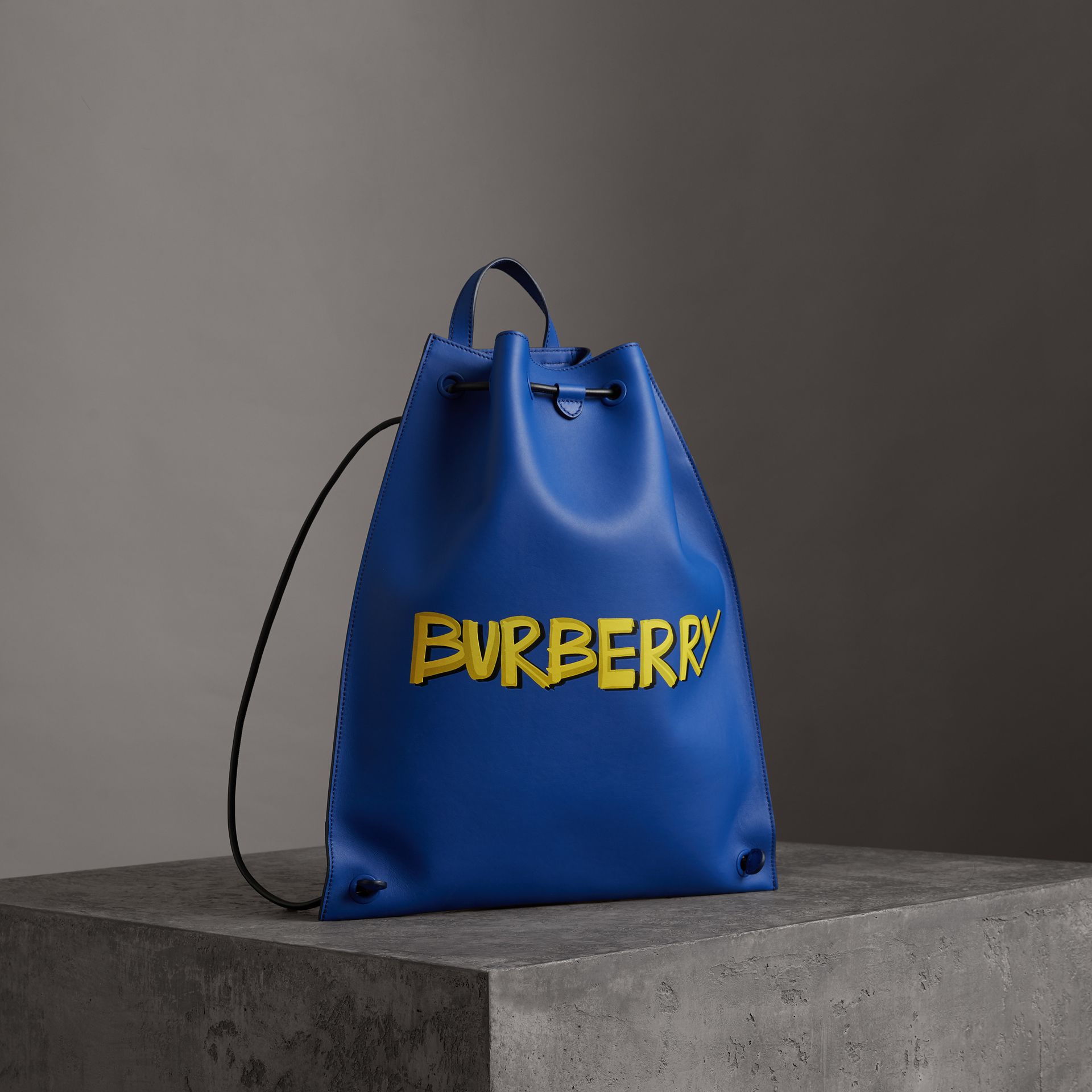 Graffiti Print Bonded Leather Drawcord Backpack in Denim Blue - Men | Burberry - gallery image 0