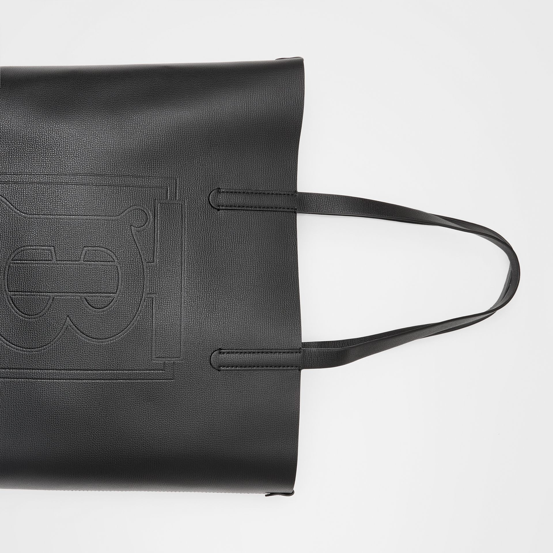 Large Embossed Monogram Motif Leather Tote in Black | Burberry - gallery image 1
