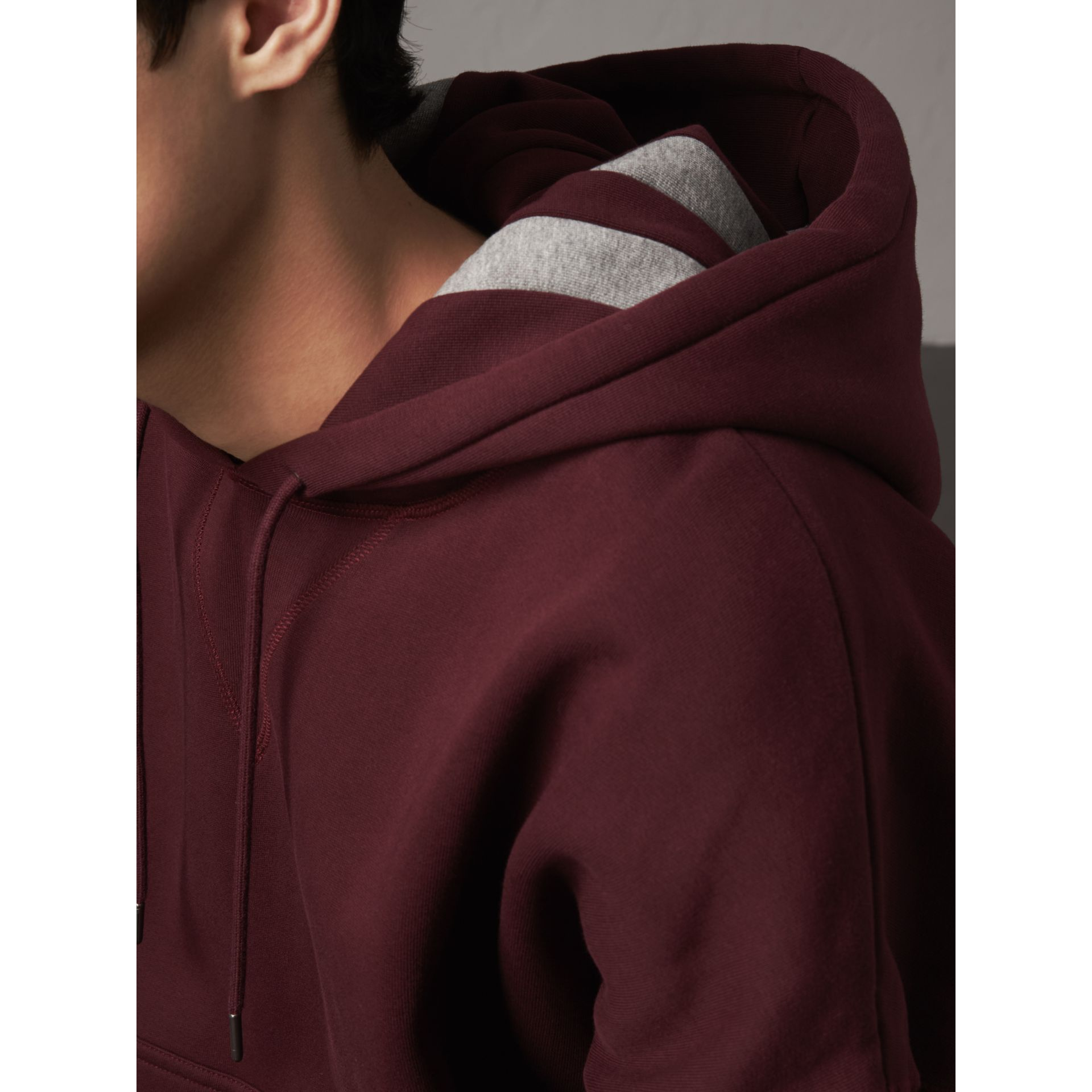 Bold Stripe Detail Oversize Hooded Sweatshirt in Deep Claret - Men | Burberry - gallery image 5