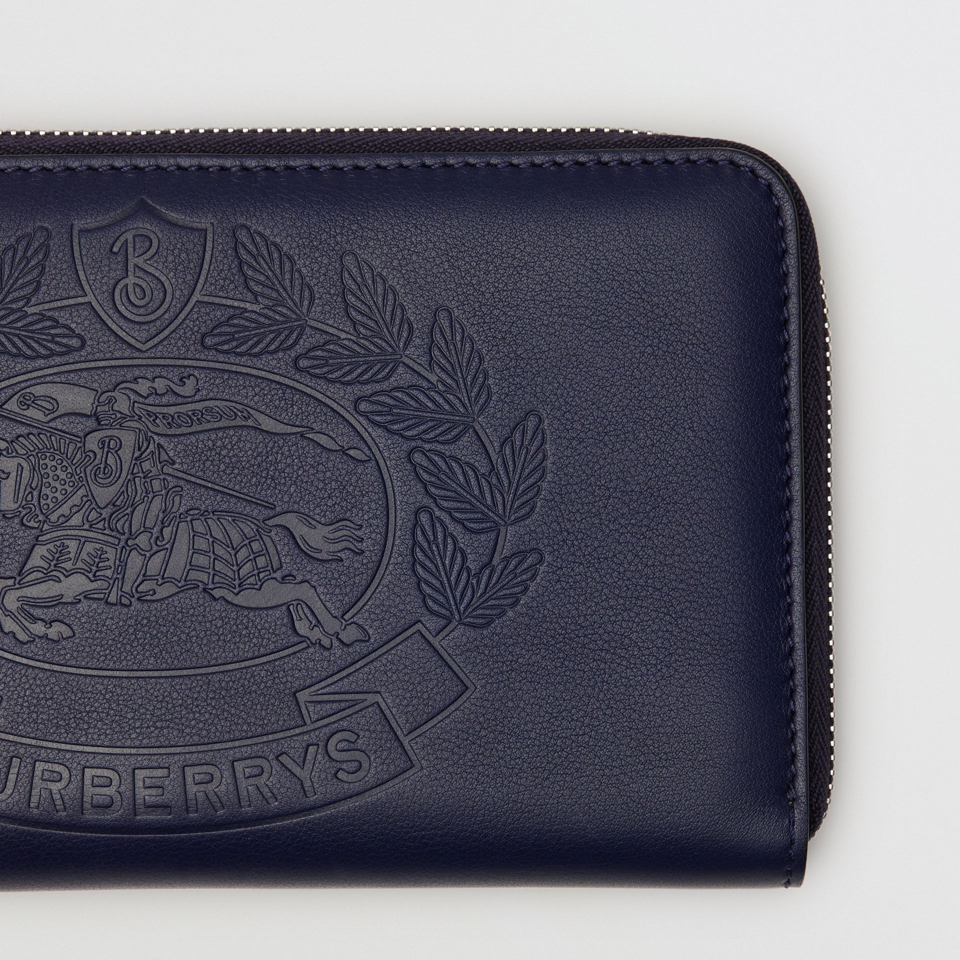 Embossed Crest Leather Ziparound Wallet in Regency Blue - Men | Burberry - gallery image 1