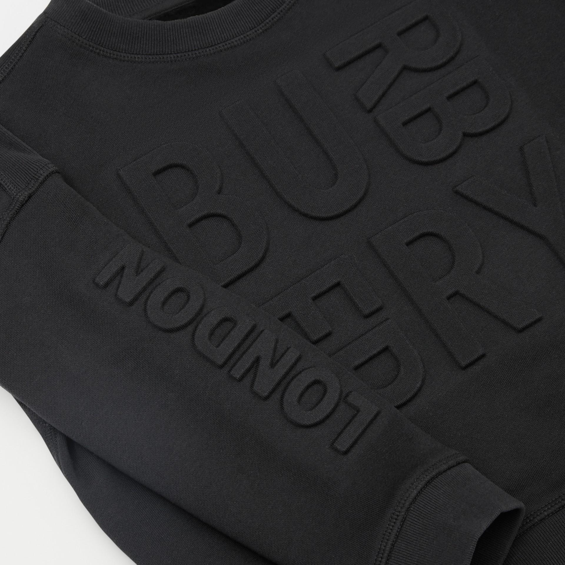 Embossed Logo Cotton Sweatshirt in Black | Burberry - gallery image 1