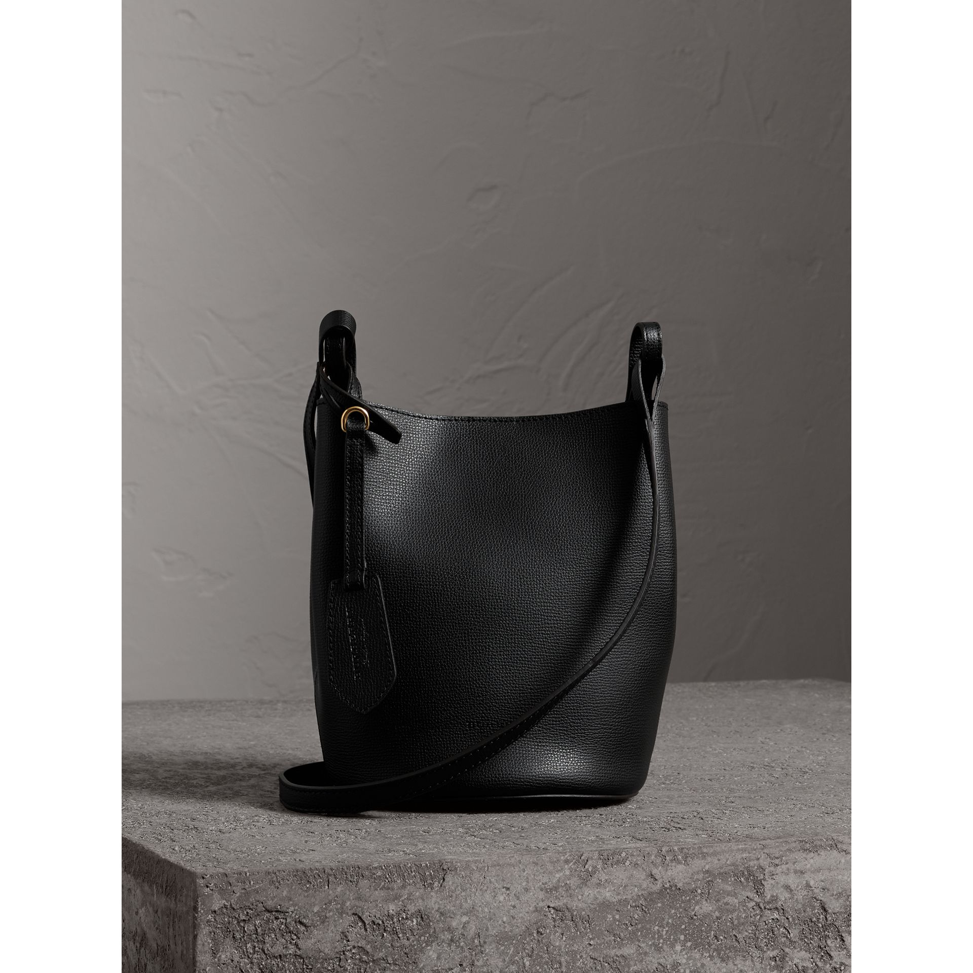 Leather and Haymarket Check Crossbody Bucket Bag in Black - Women | Burberry United Kingdom - gallery image 1