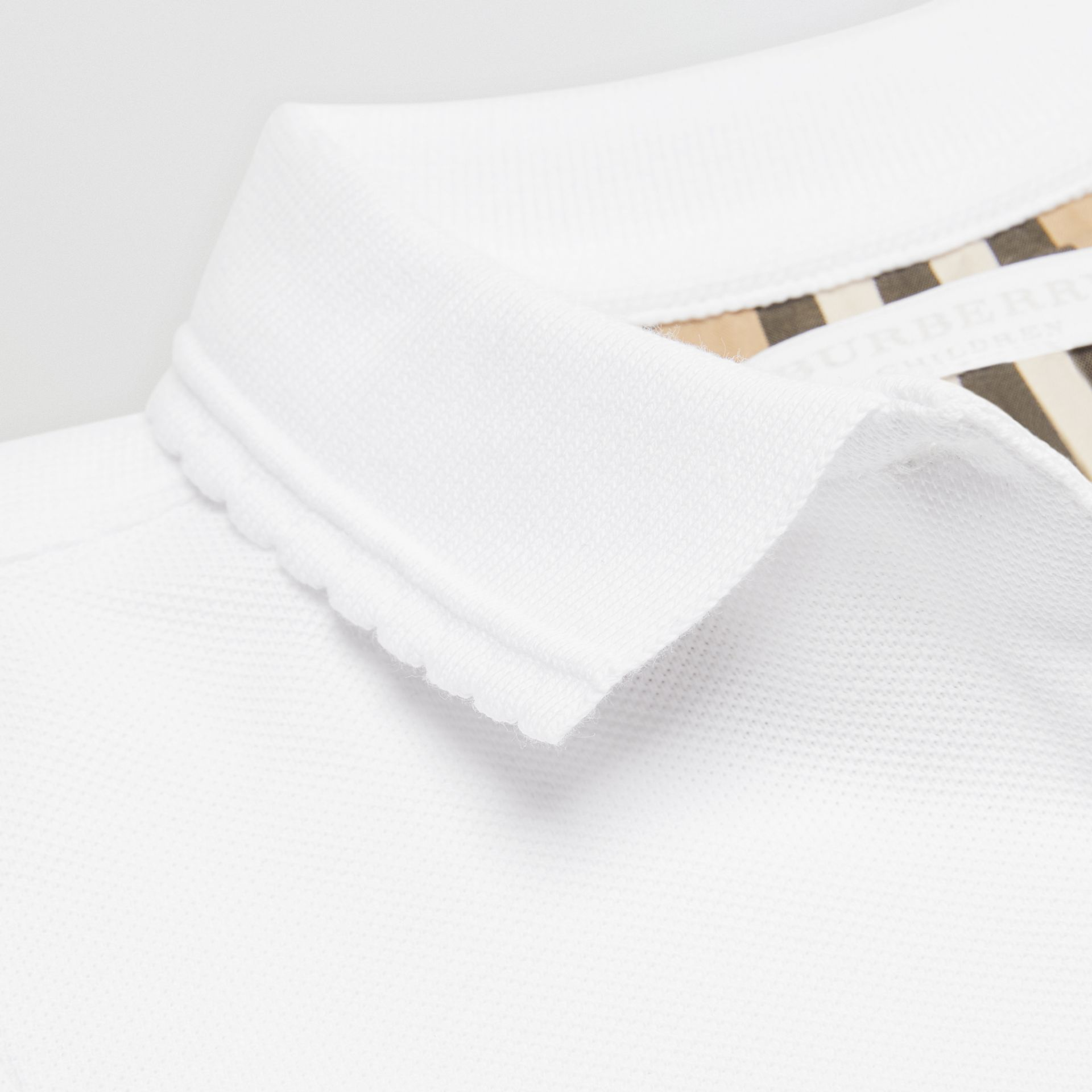 Logo Print Cotton Piqué Polo Shirt in White | Burberry Australia - gallery image 1