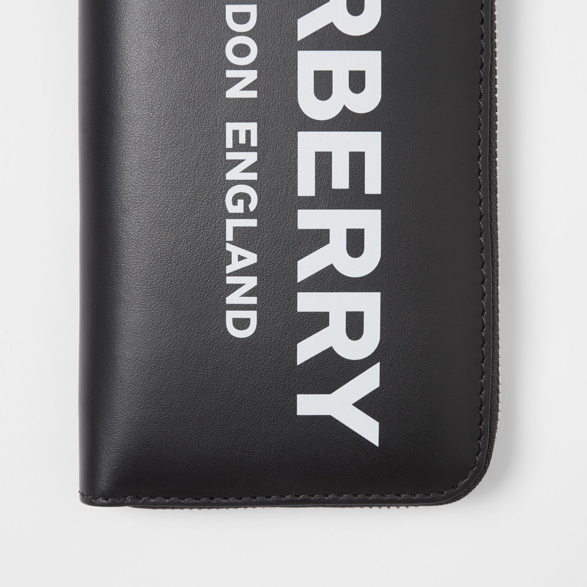 Logo Print Leather Ziparound Wallet in Black | Burberry Australia - gallery image 1