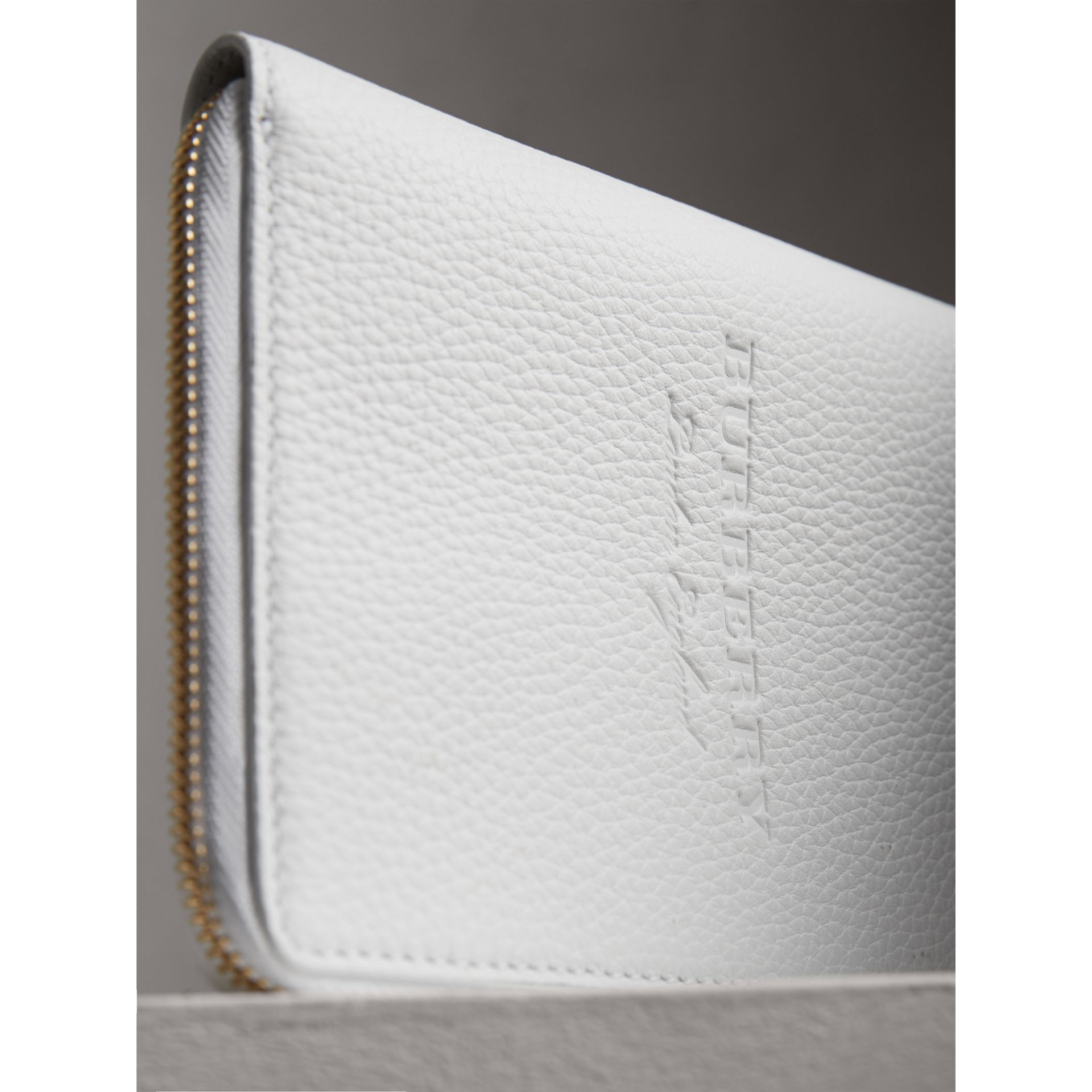 Embossed Grainy Leather Ziparound A6 Notebook Case in Chalk White | Burberry - gallery image 1